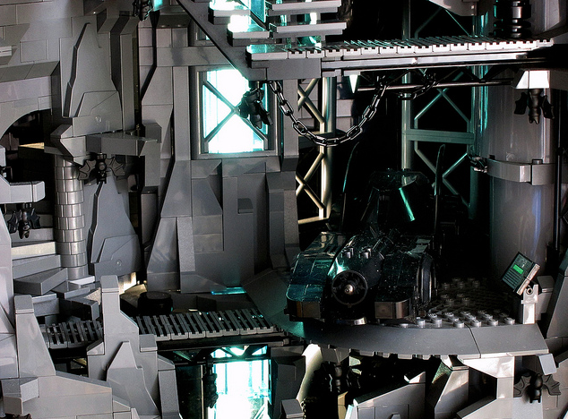 The Batmobile waits in the Lego Batcave