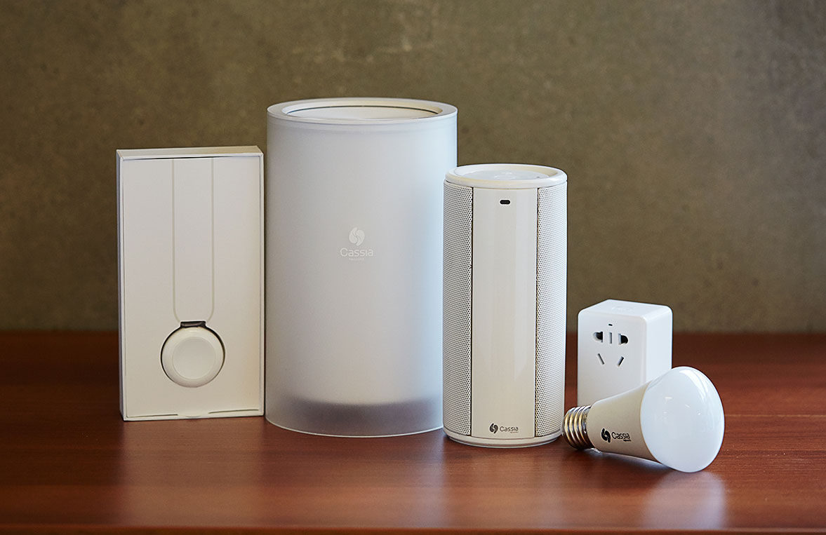 Cassia Networks' Bluetooth-powered smart-home products include, from left to right, an emergency help pager, a hub that can broadcast and detect Bluetooth signals throughout a house, a speaker, a remote-controlled power switch​ and a lightbulb.