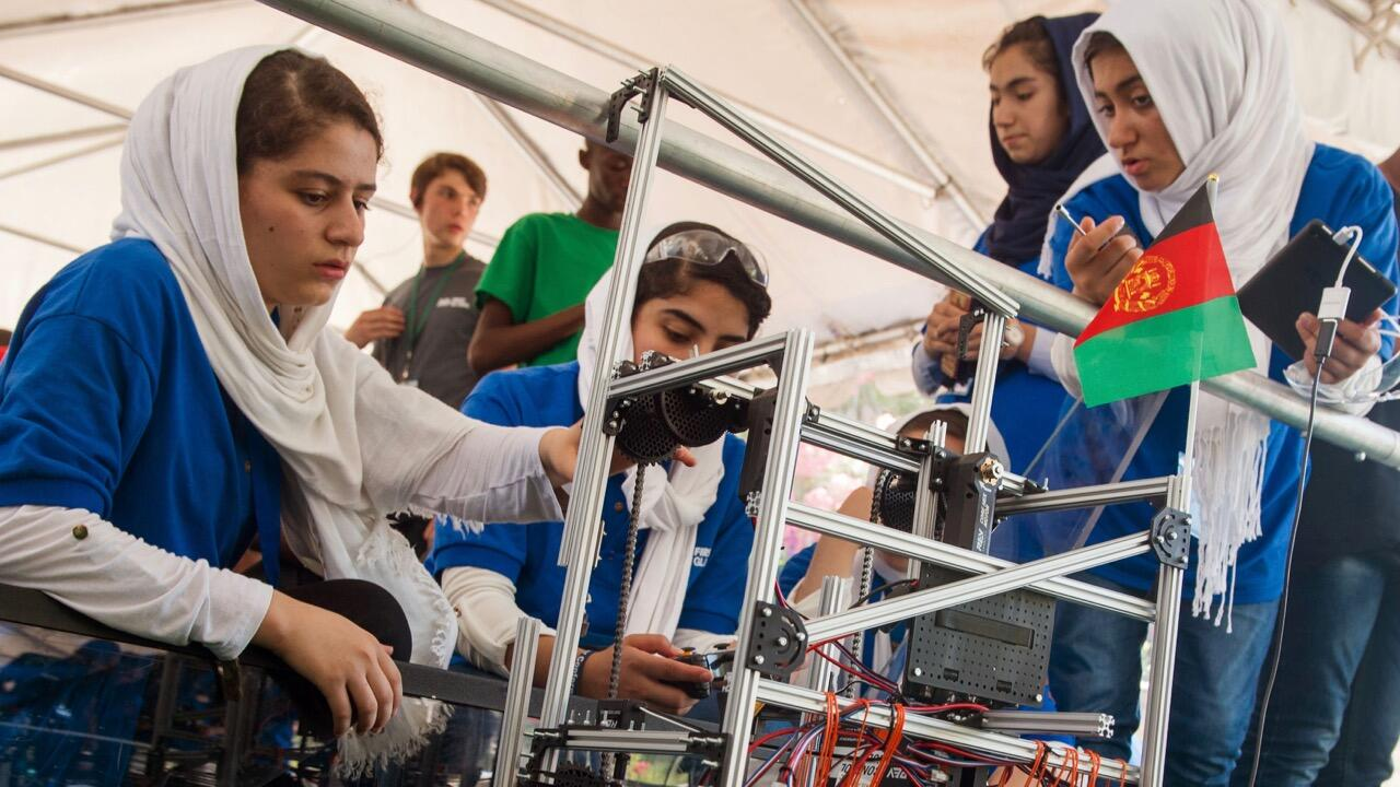 Members of the Afghan all-girls robotics team work with their robot in the practice area between 2017 FIRST Global Challenge competitions in Washingto