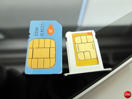 A standard SIM card next to a MicroSIM card, which ships inside 3G versions of the iPad.