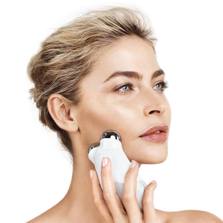 womens-face-with-nuface-device-rubbing-on-skin