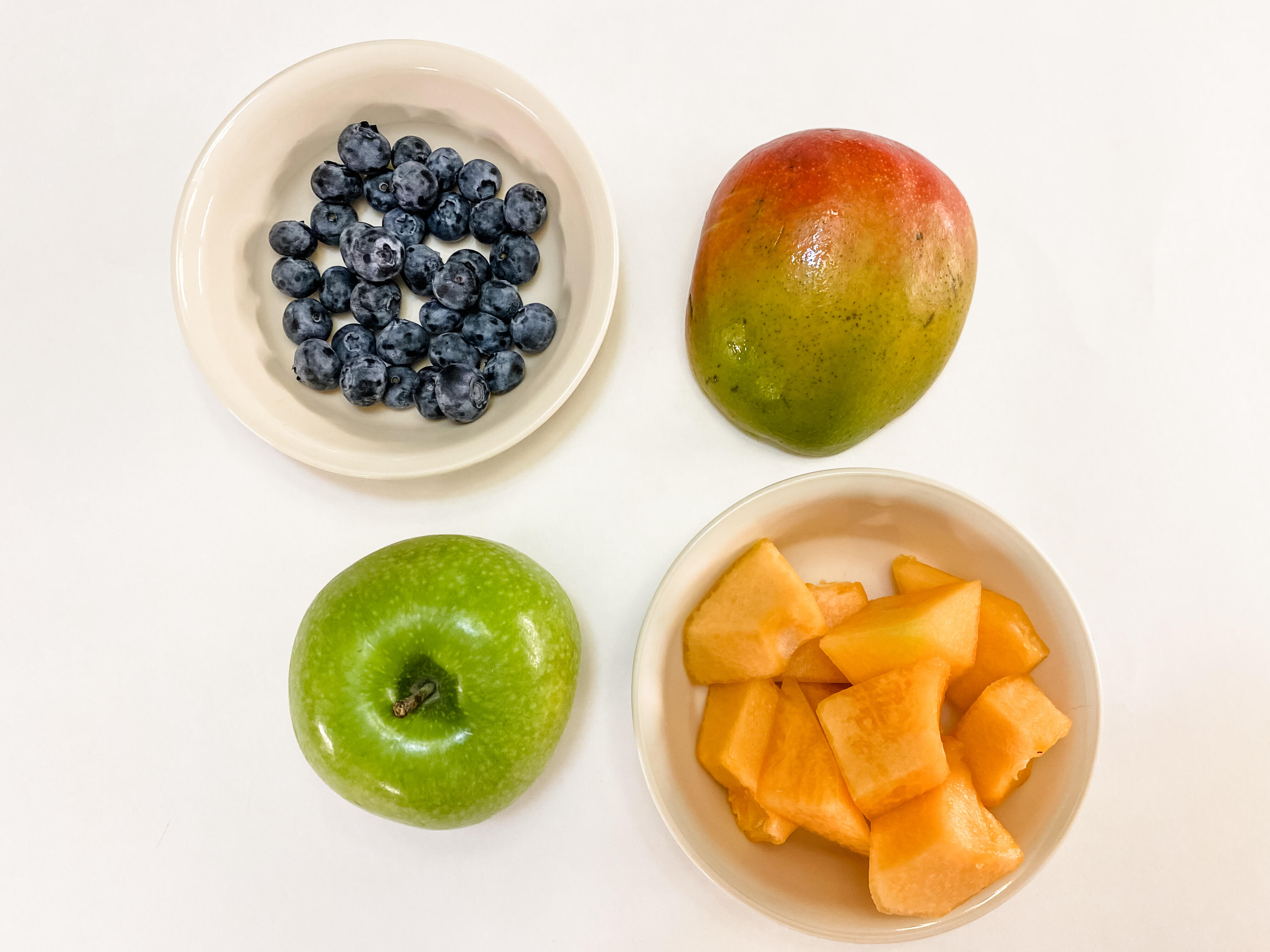 Five servings of fruit: half a cup of blueberries, half a mango, an apple, a cup of melon