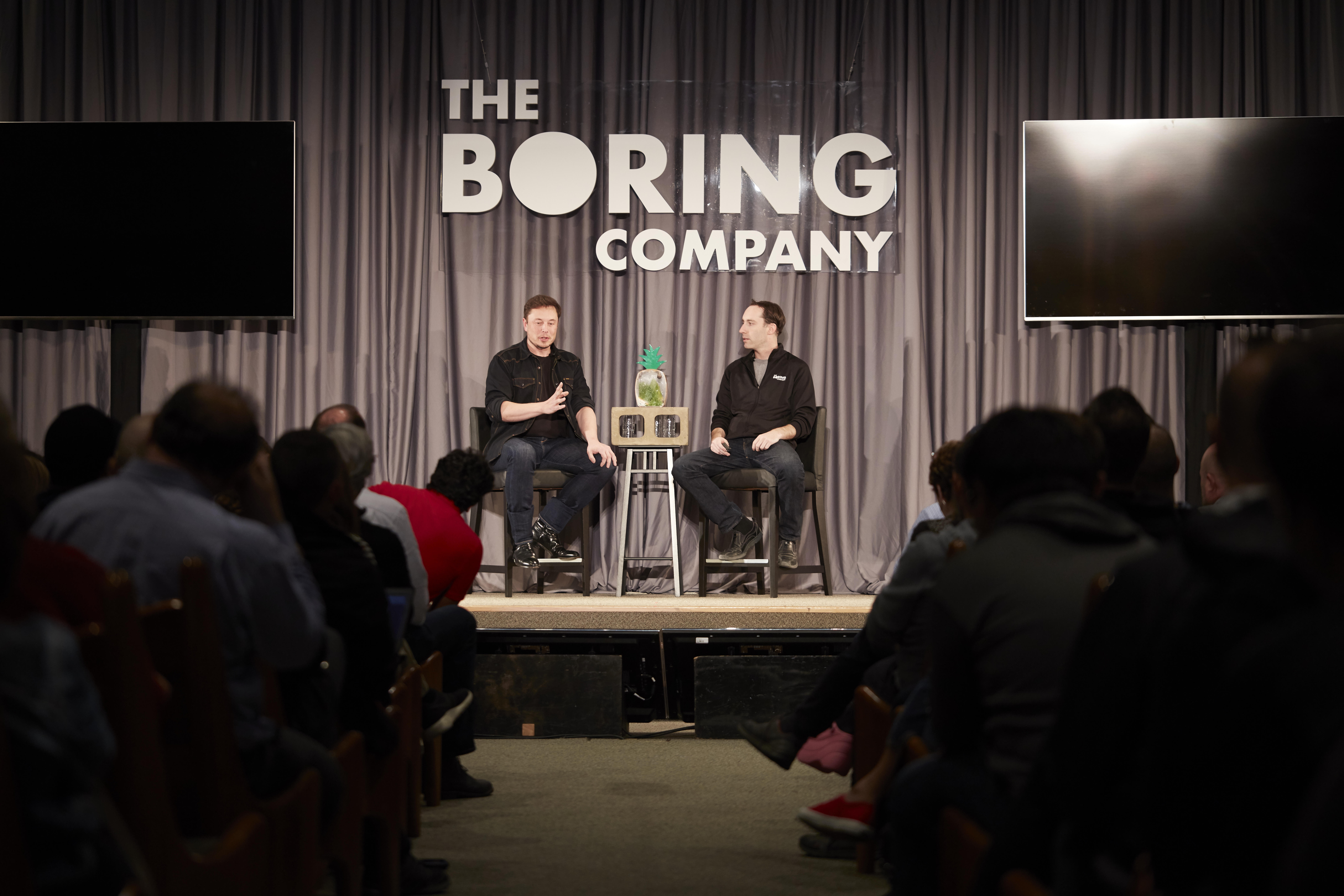 Boring Company founder Elon Musk and director Steve Davis speak at the Leo Baeck Temple in Los Angeles.