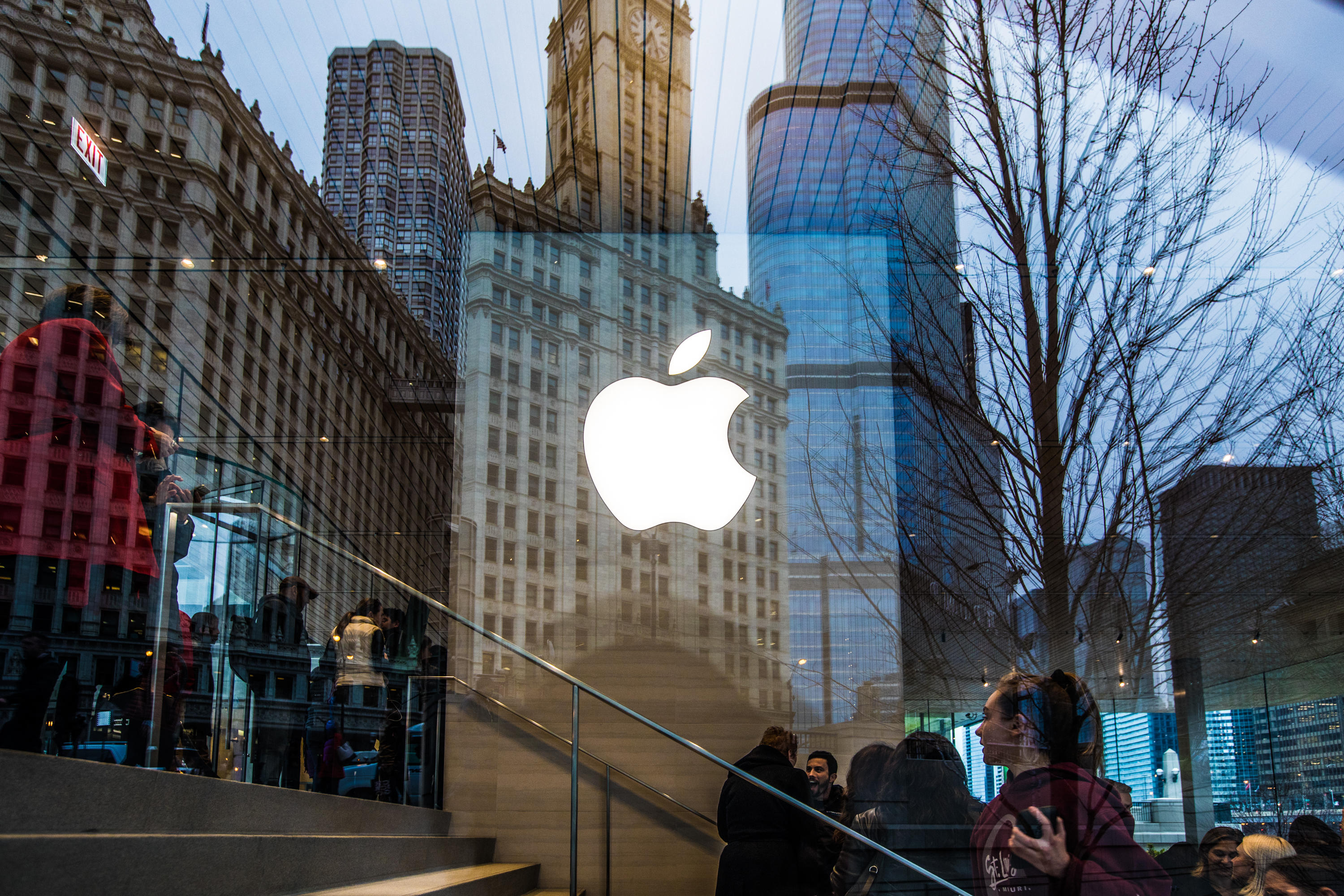 Gorgeous old Chicago buildings reflected in the window of the Apple Store there. Apple's logo is in the center.