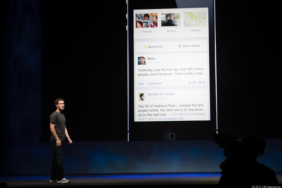 Zuckerberg shows off how Facebook's new Timeline looks on a mobile device.