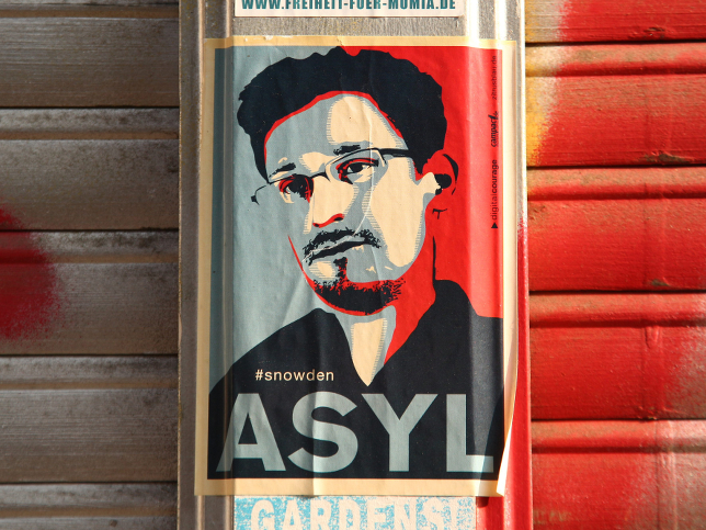 A sticker in Berlin, demanding asylum for Edward Snowden. The European Parliament has passed a symbolic resolution saying the NSA leaker should be protected from extradition to the US.