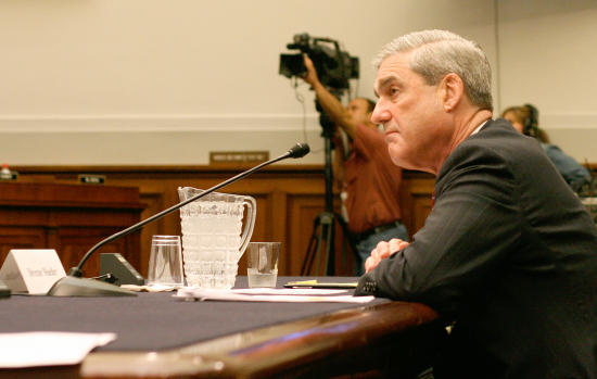 """FBI Director Robert Mueller tells Senate panel that agents need to """"be able to obtain those communications,"""" in this file photo."""