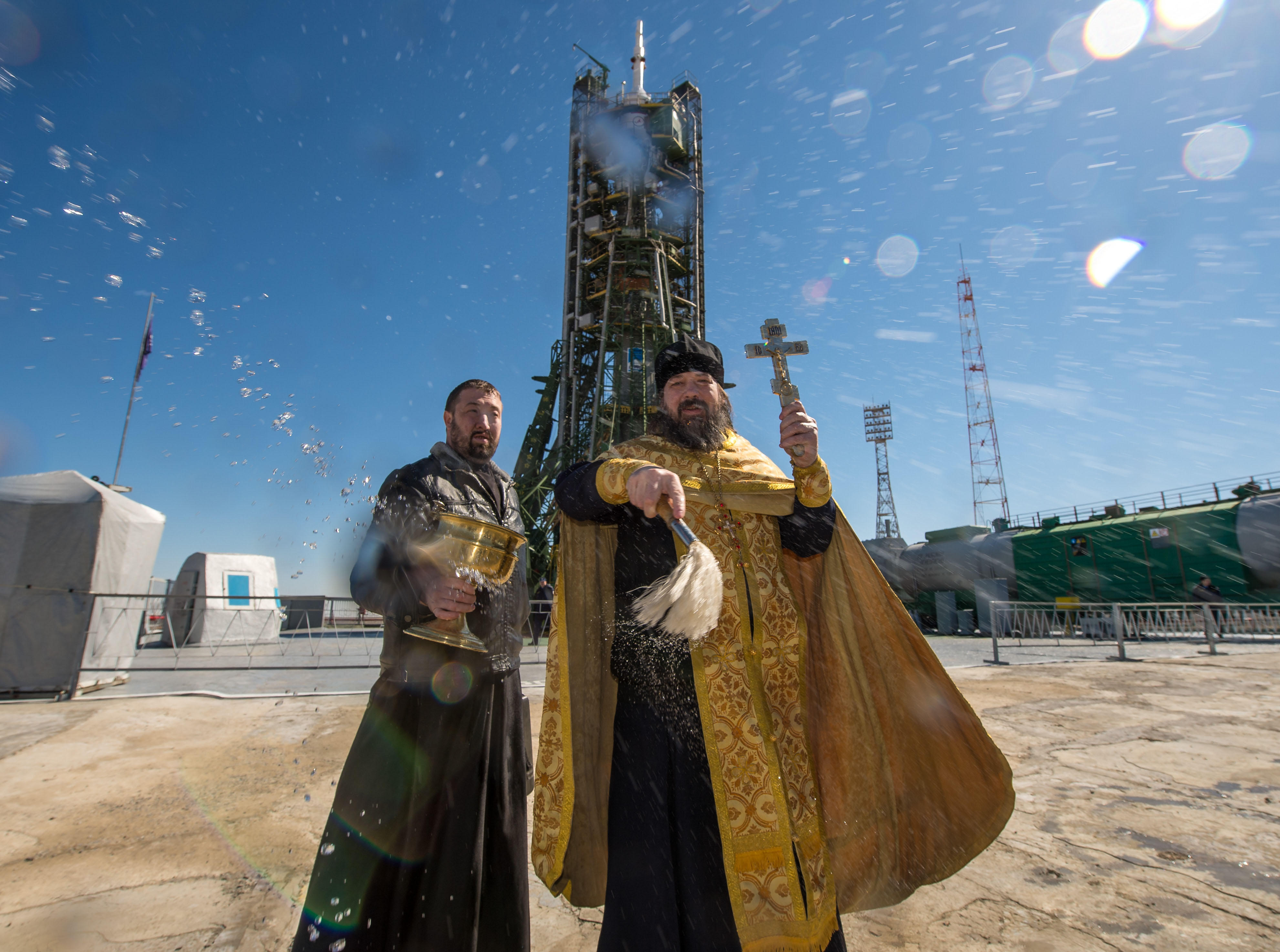 An Orthodox priest blesses members of the media after he blessed the Soyuz rocket at the Baikonur Cosmodrome launch pad in Kazakhstan in 2015.