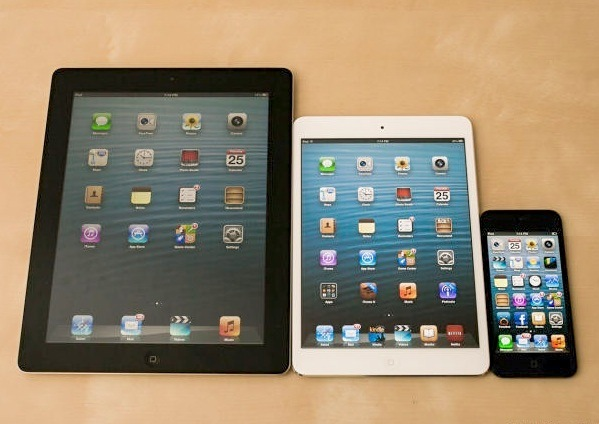 The iPad 4, iPad Mini, and iPhone 5. Loyalty to Apple is increasing in the age of multiple device ownership says Goldman Sachs.