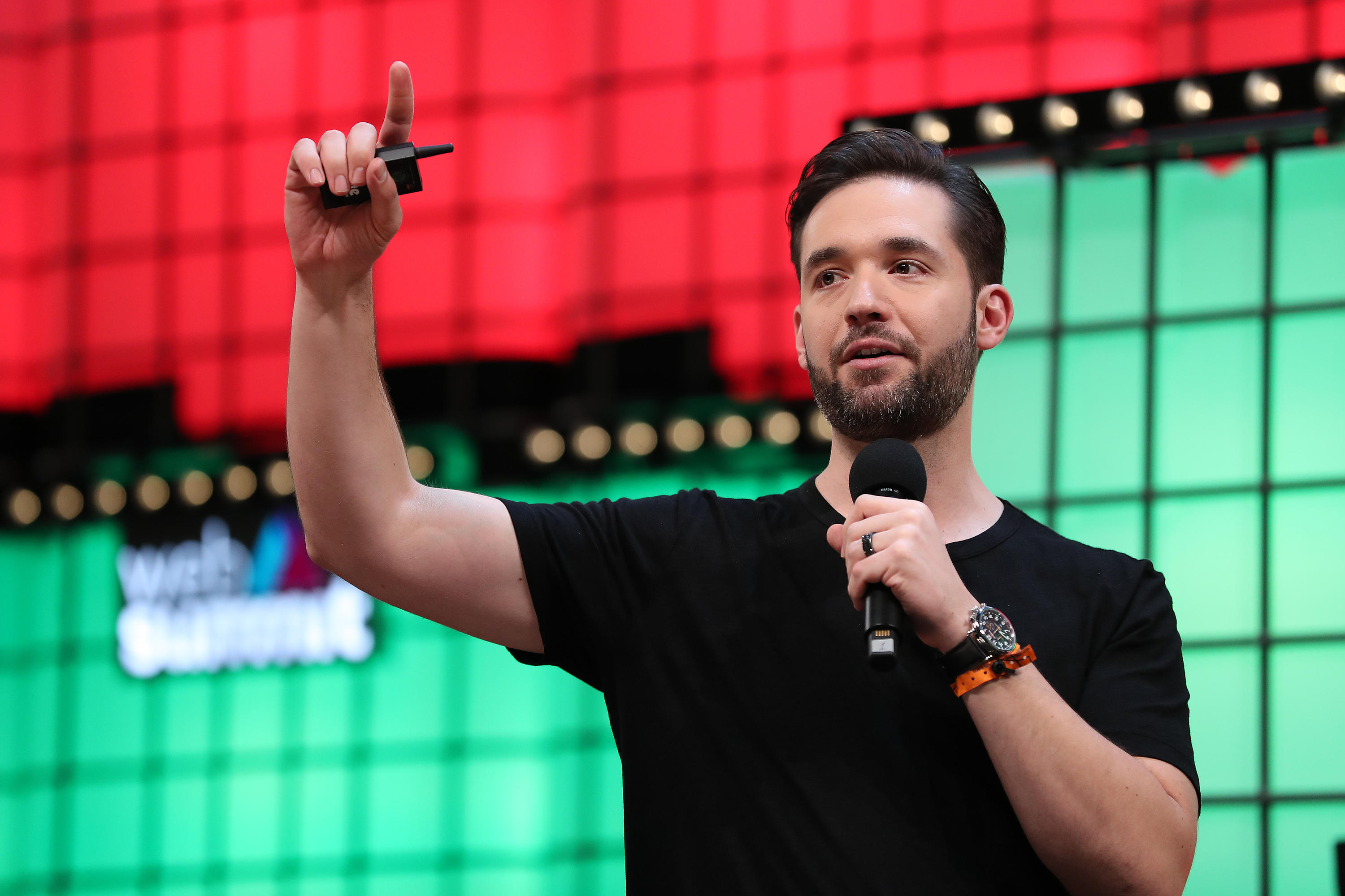 Alexis Ohanian gestures with a microphone