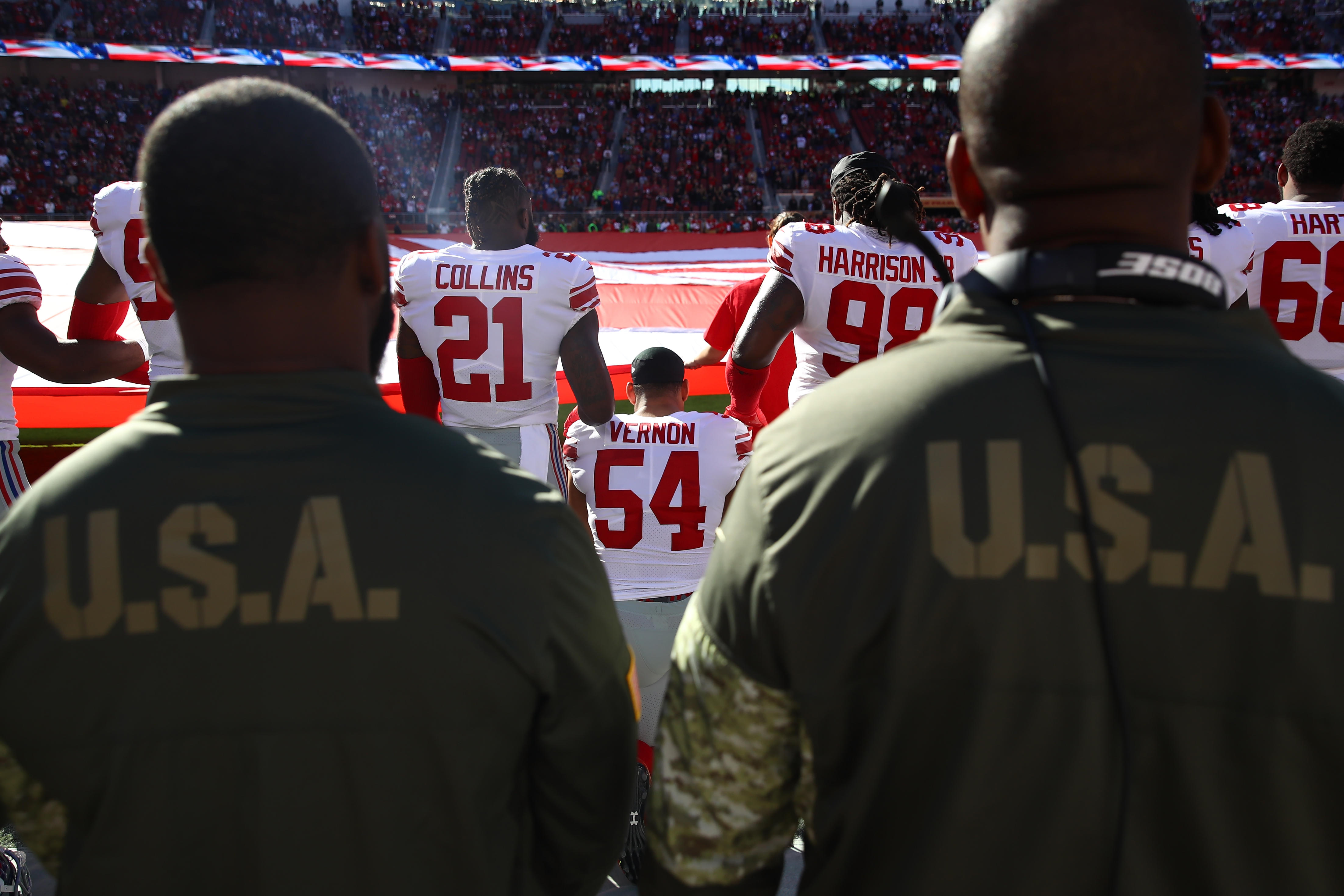 A New York Giants player kneels during the national anthem last November.
