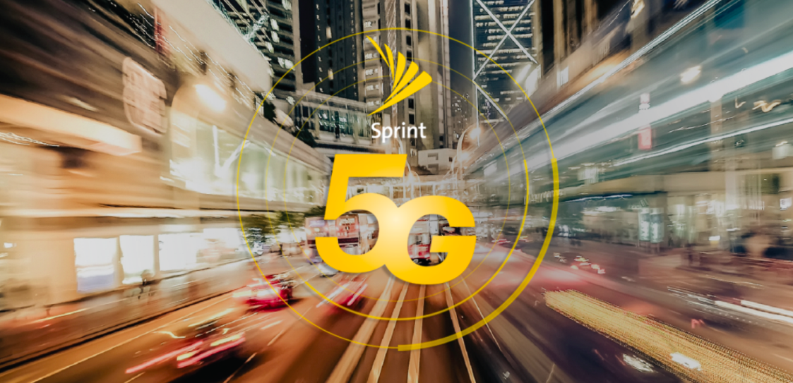 Sprint logo and 5G superimposed on a city street scene blurred to indicate speedy movement.