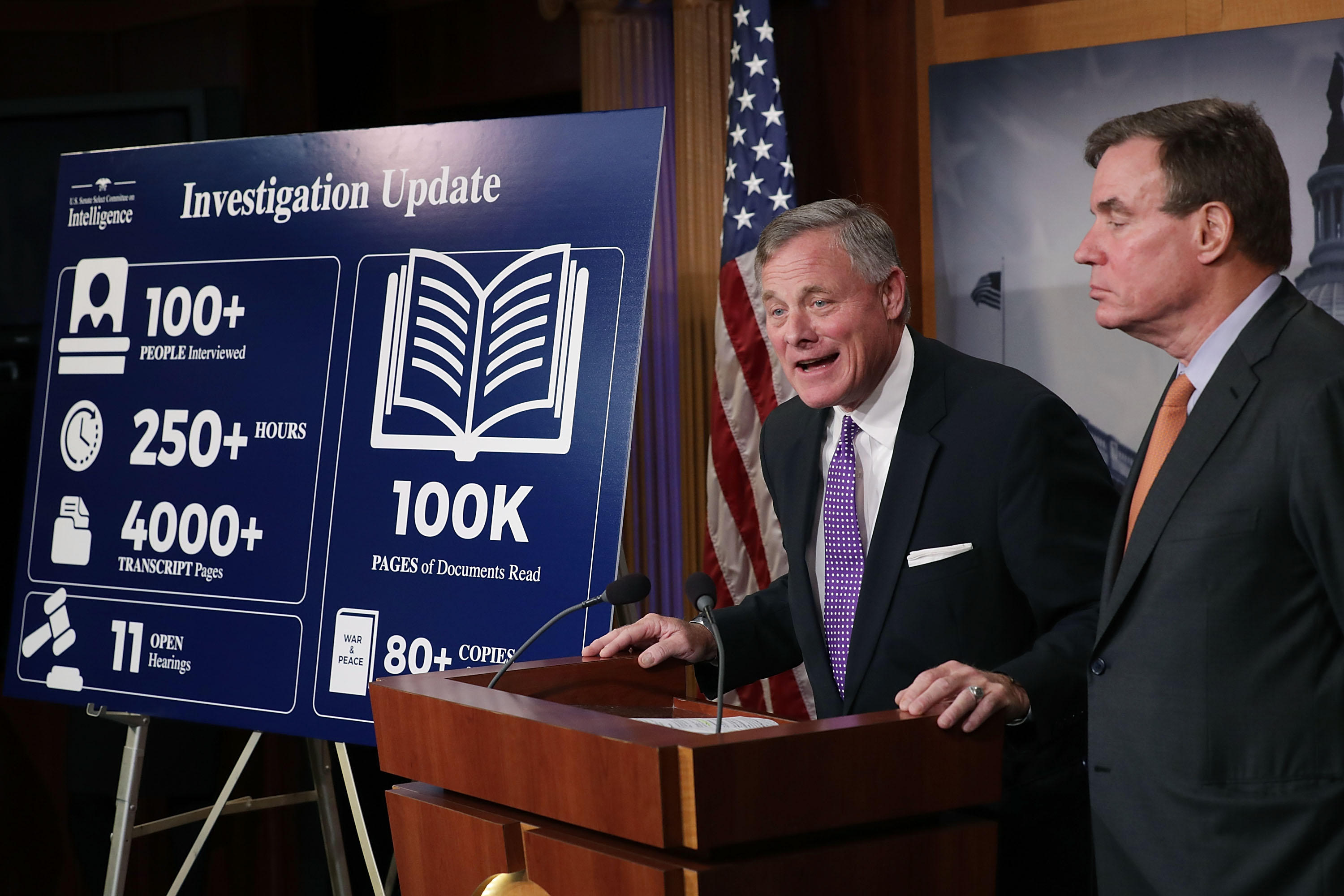Sens. Richard Burr (left) and Mark Warner deliver an update on an inquiry into Russian interference in the 2016 presidential election.