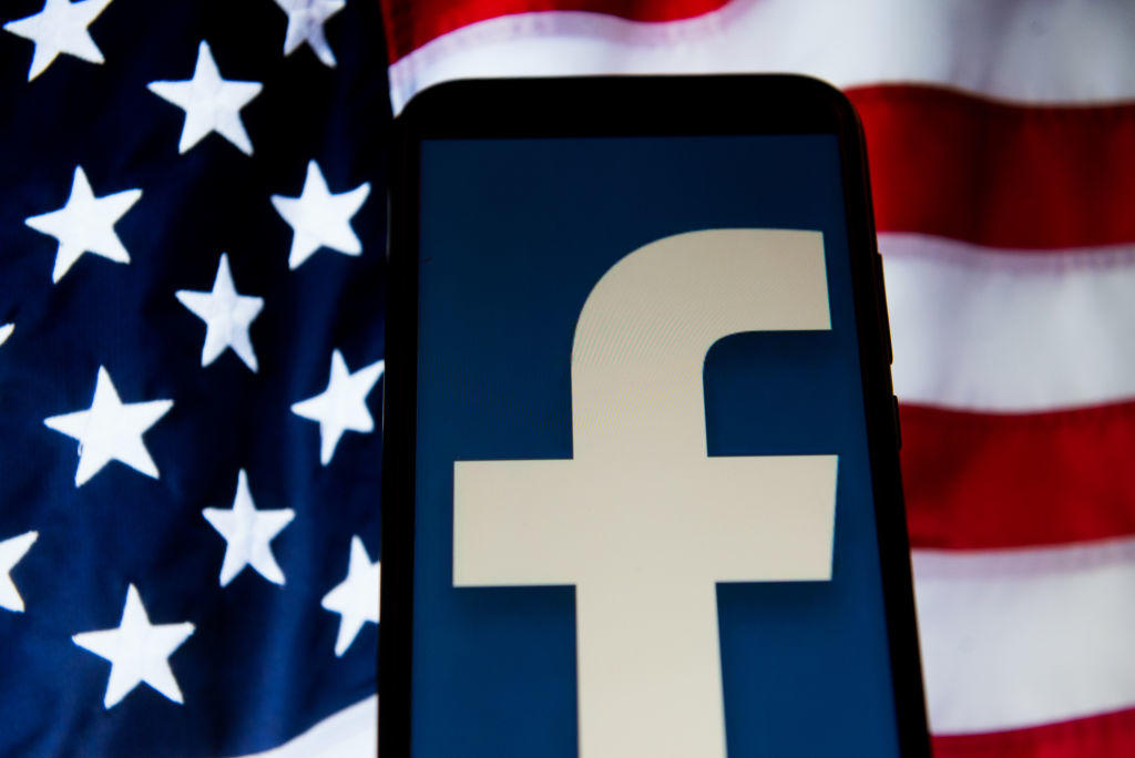 Facebook logo is seen on an Android mobile device with USA