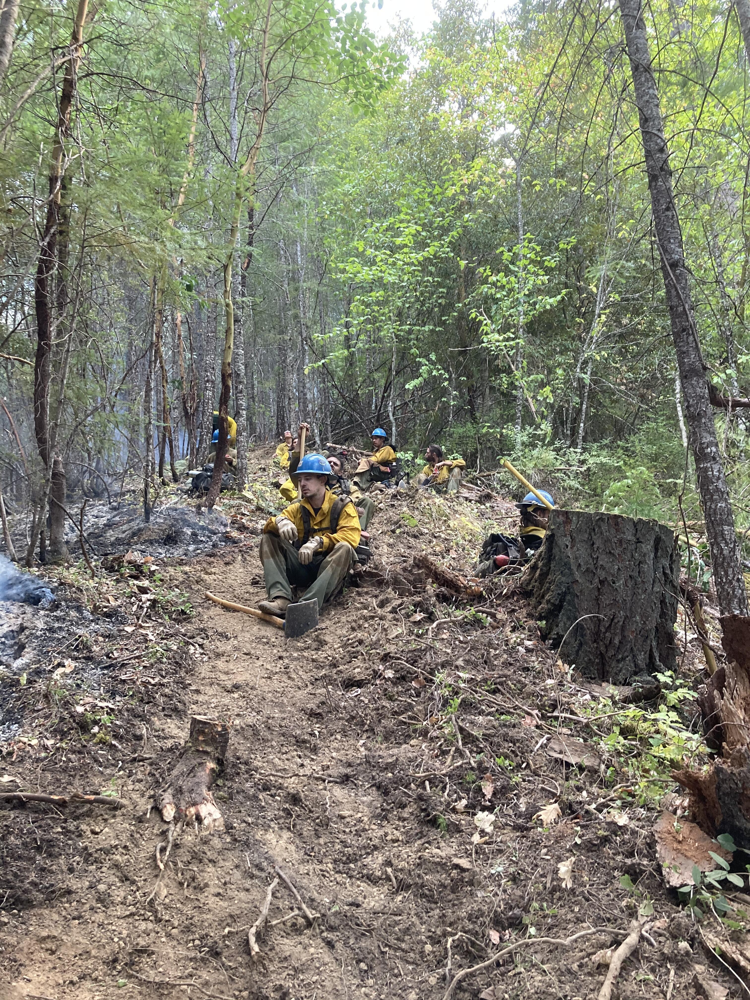 Carson Hotshots rest on a trail after fighting a wildfire