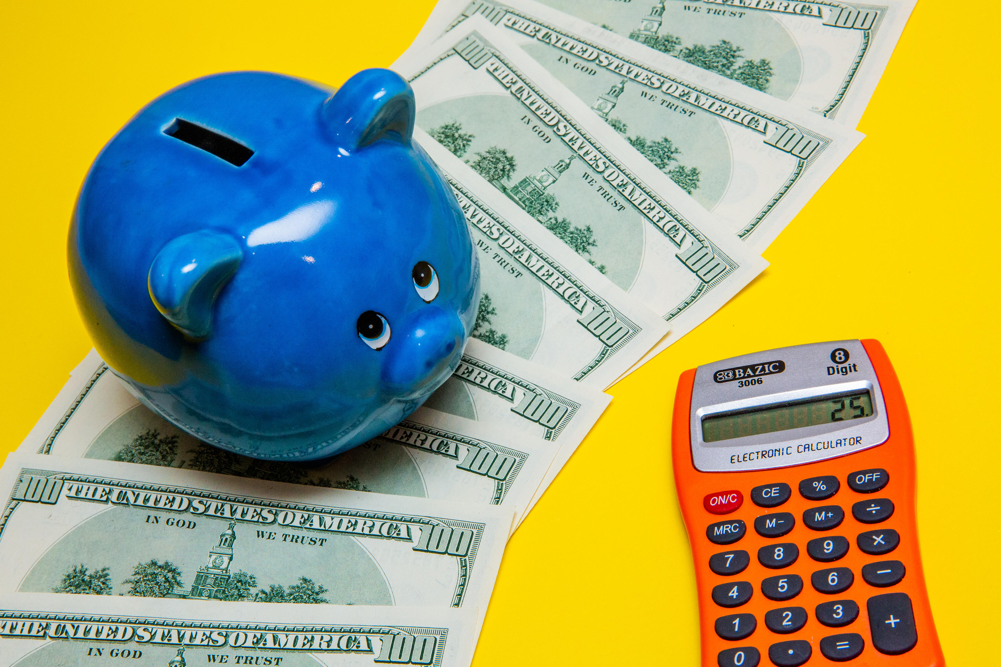piggy bank and cash with calculator