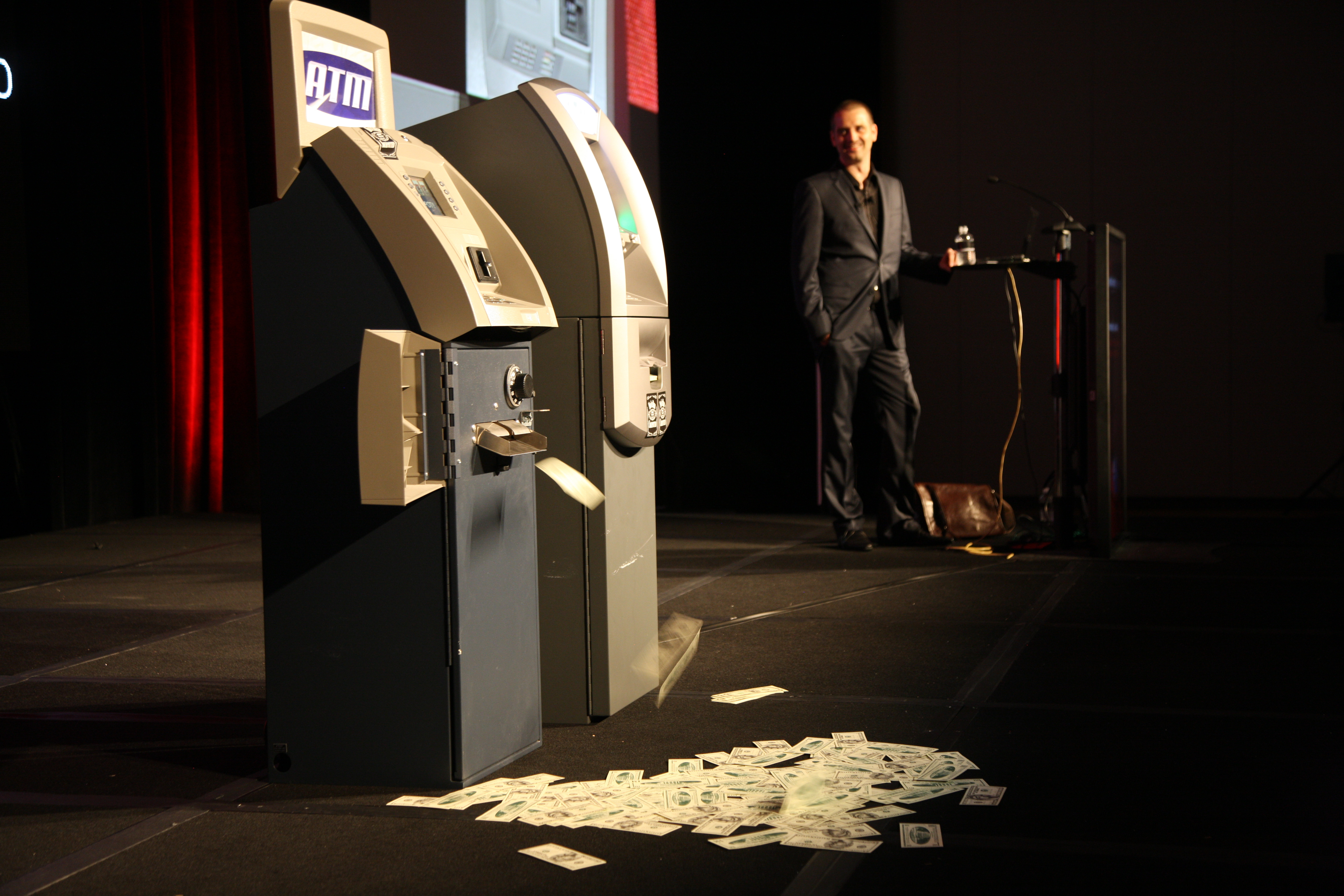Security researcher Barnaby Jack demonstrates how he bypassed the security of two ATMs.