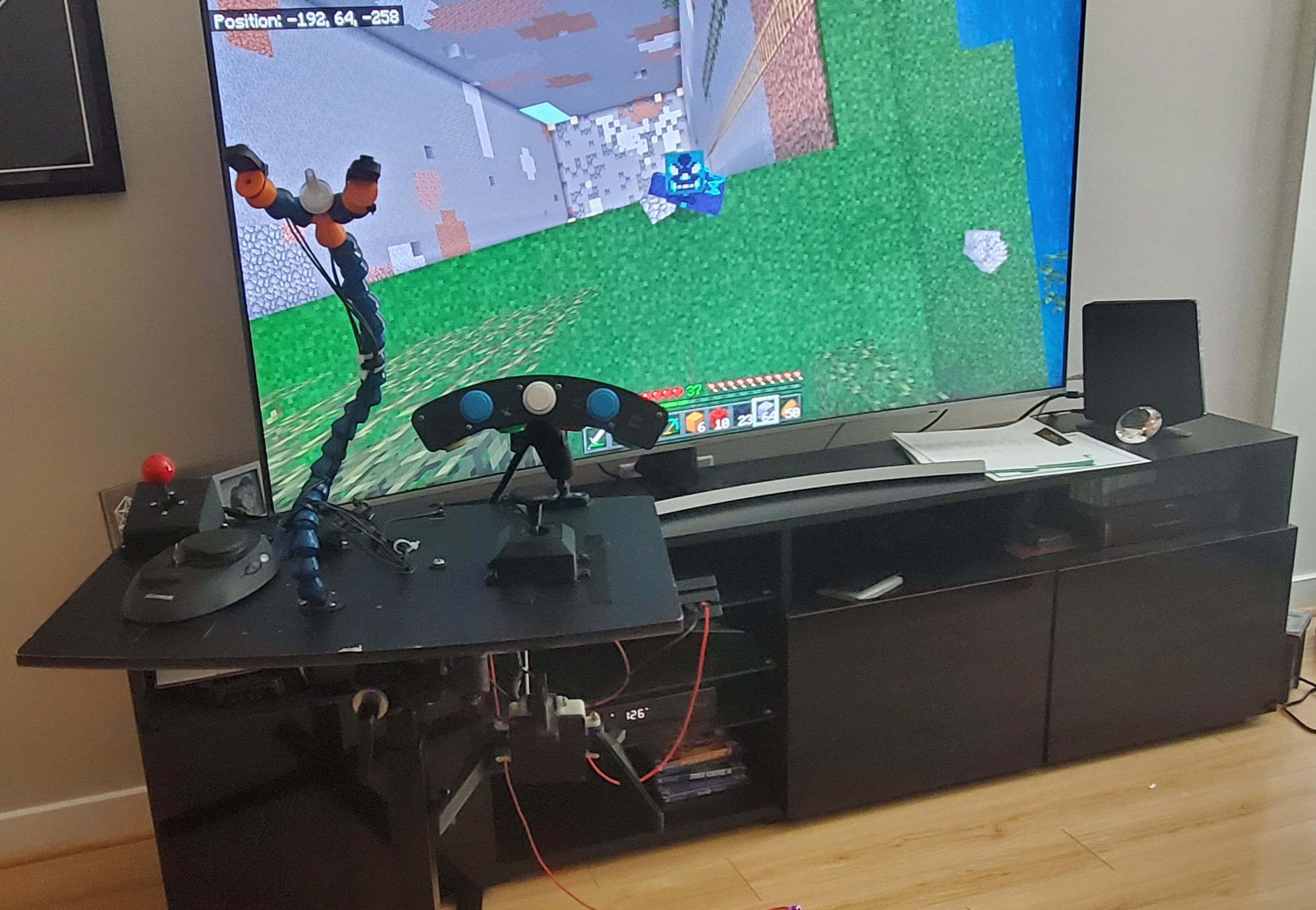 An adapted controller rig, with Minecraft on screen.