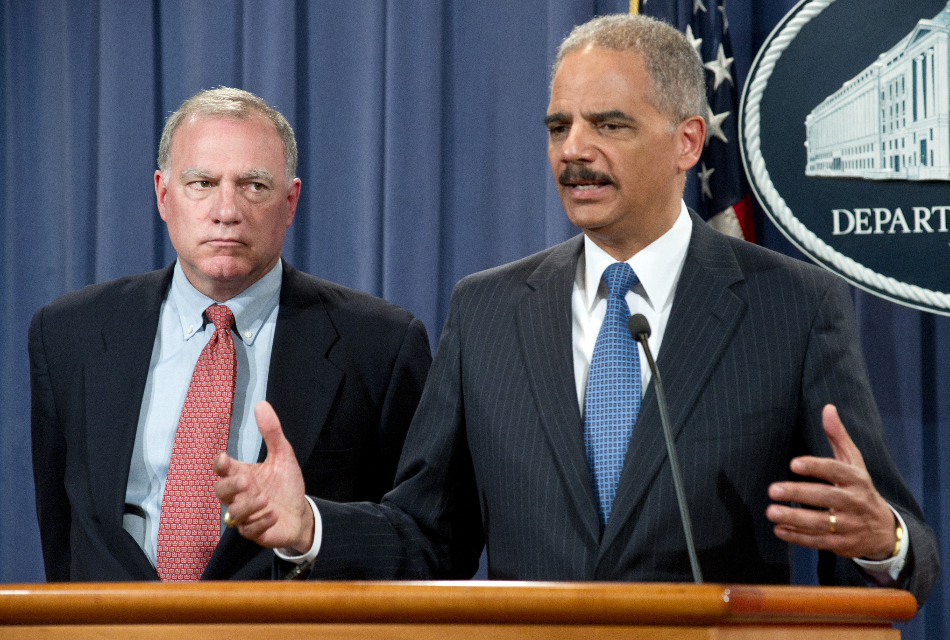 U.S. Attorney General Eric Holder with Connecticut Attorney General George Jepsen announcing a complaint against Apple and settlements with publishers, at a 2012 press conference.