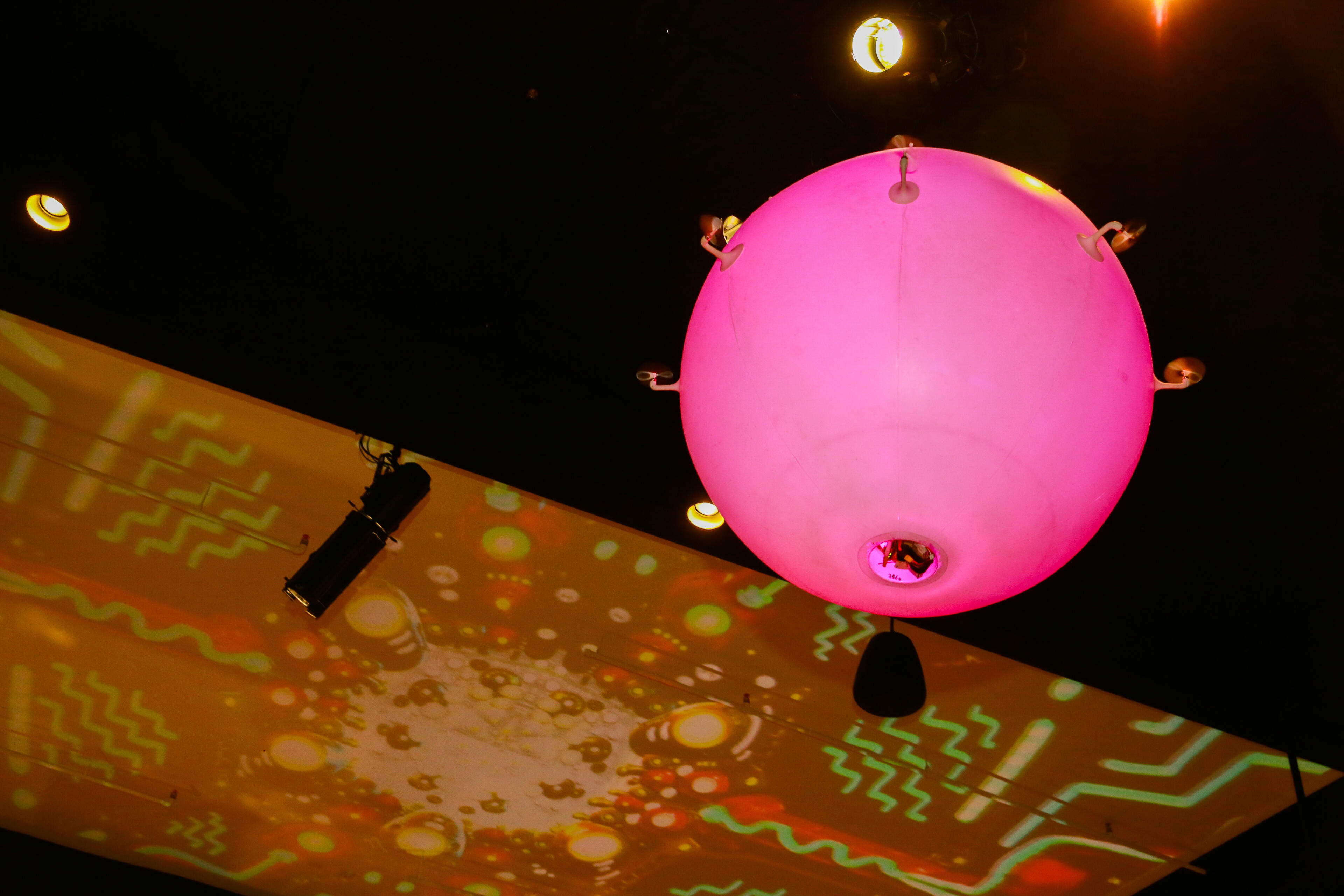These drone-balloons light up and change color, and they're propelled by a set of tiny fans. They were custom created for Planet 13 by Airstage in Germany.