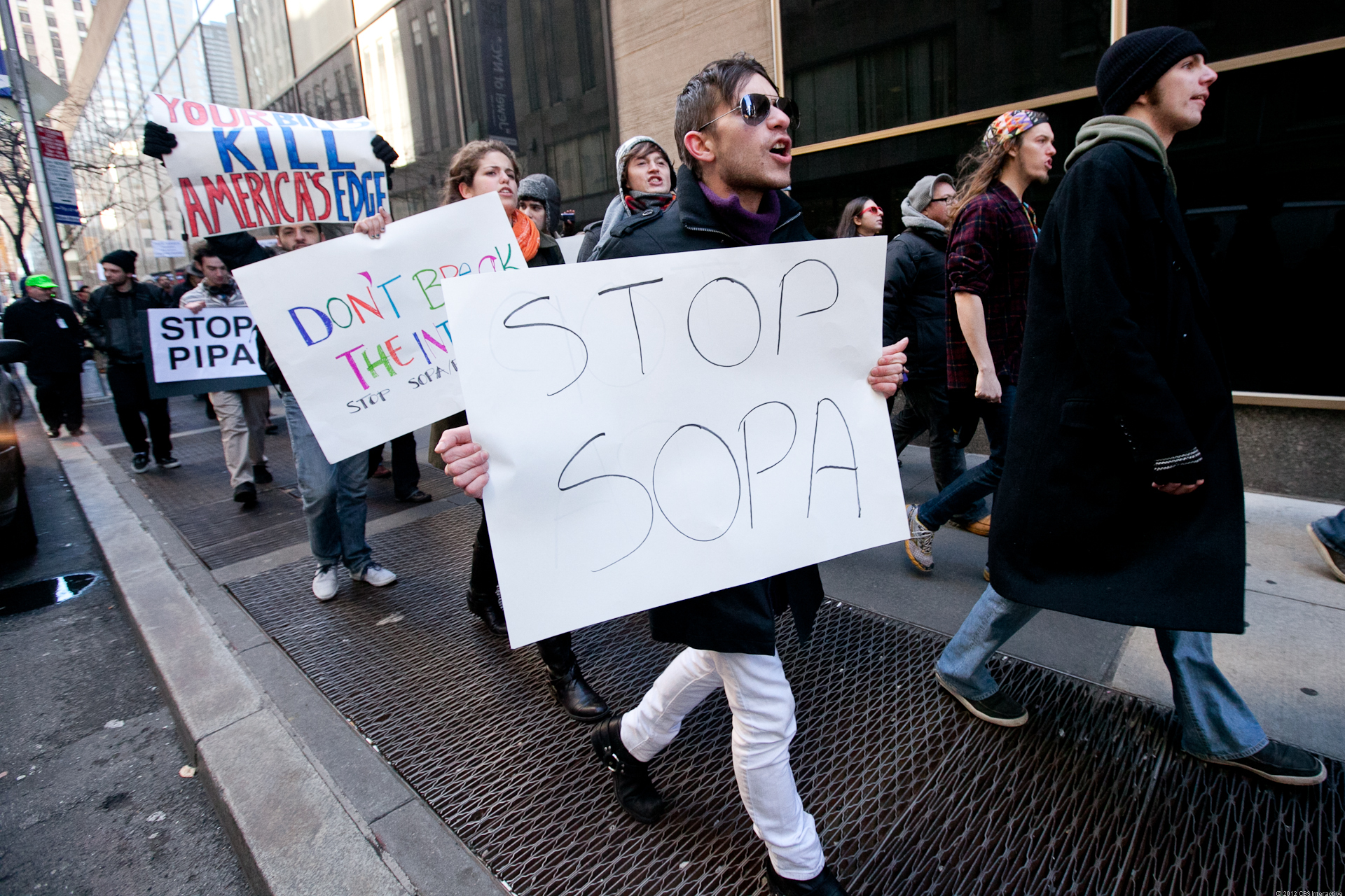 Activists take to the Manhattan streets one year ago to protest the Stop Online Piracy Act and the Protect IP Act.