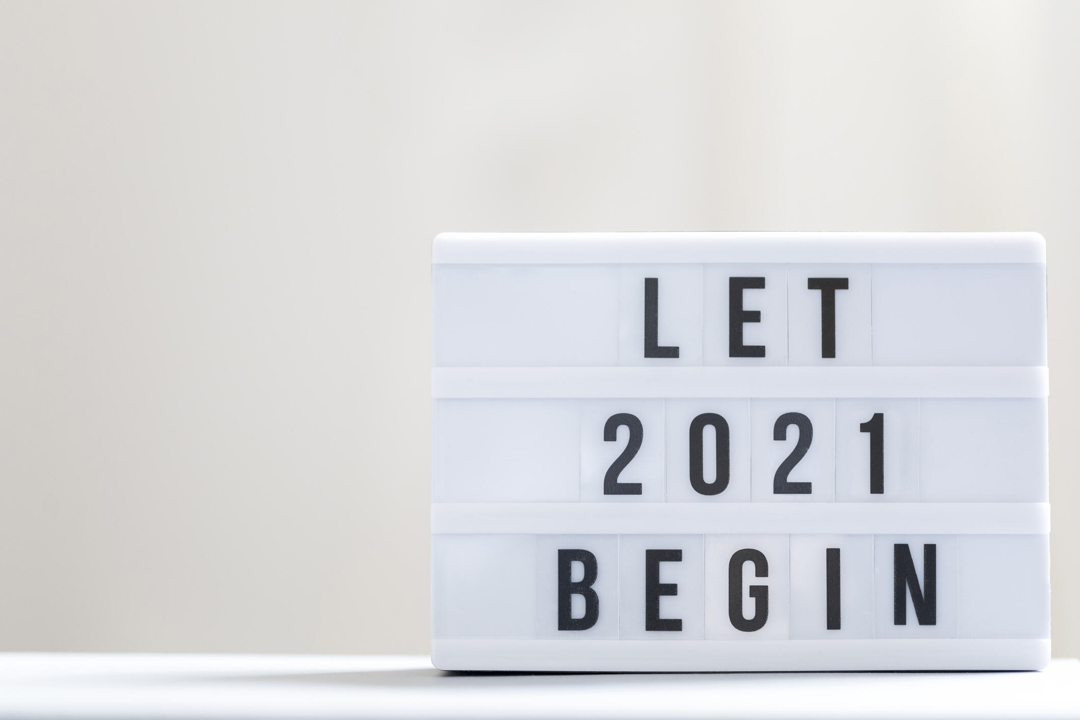 """A sign that says """"Let 2021 begin"""""""