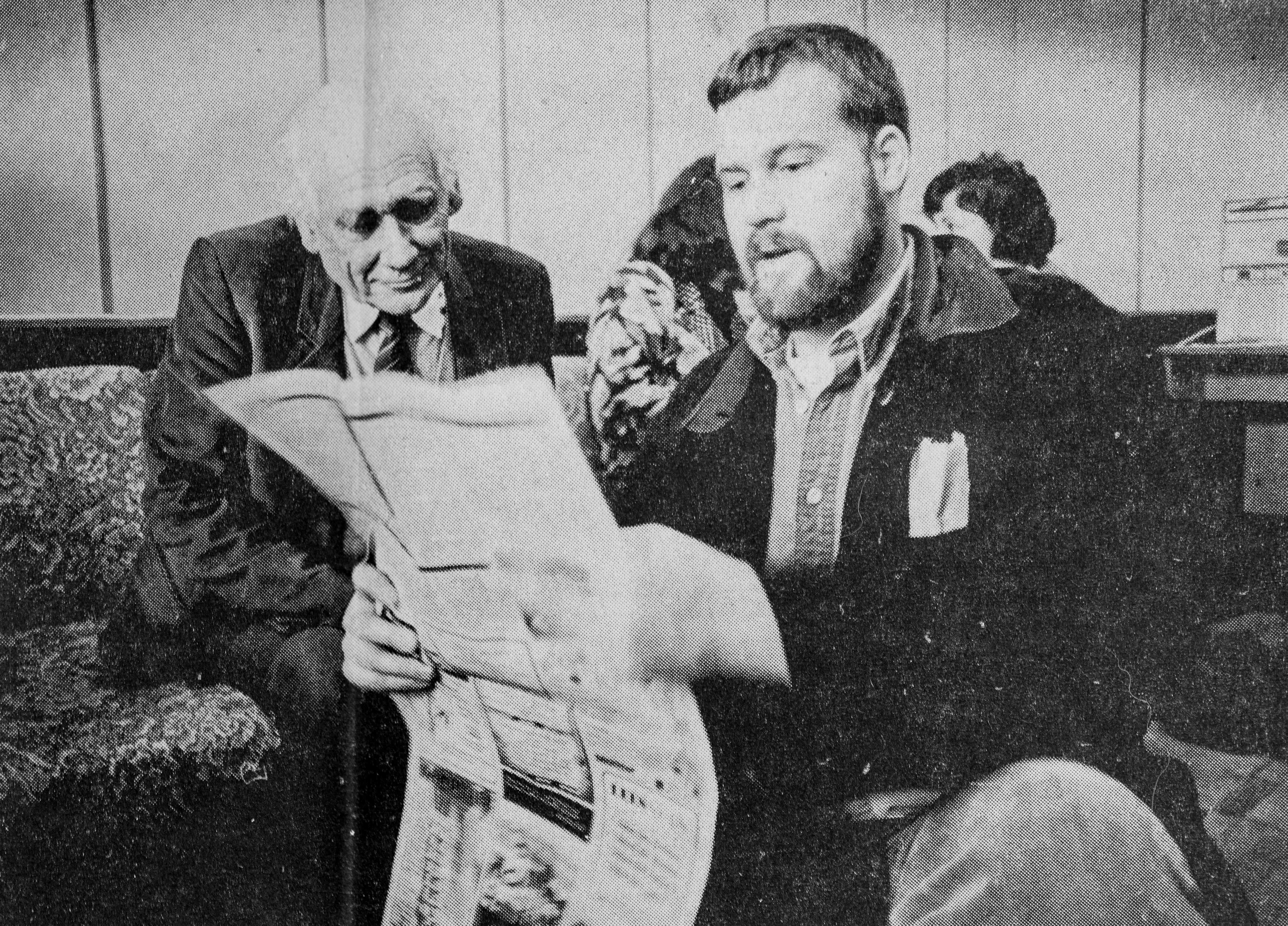 CNET reporter Stephen Shankland shows a copy of the newspaper where he worked in 1995, the Los Alamos Monitor, to Russian nuclear weapons physicist Viktor Adamsky. Adamsky helped design the most powerful nuclear weapon ever exploded, the Tsar Bomba from 1961.