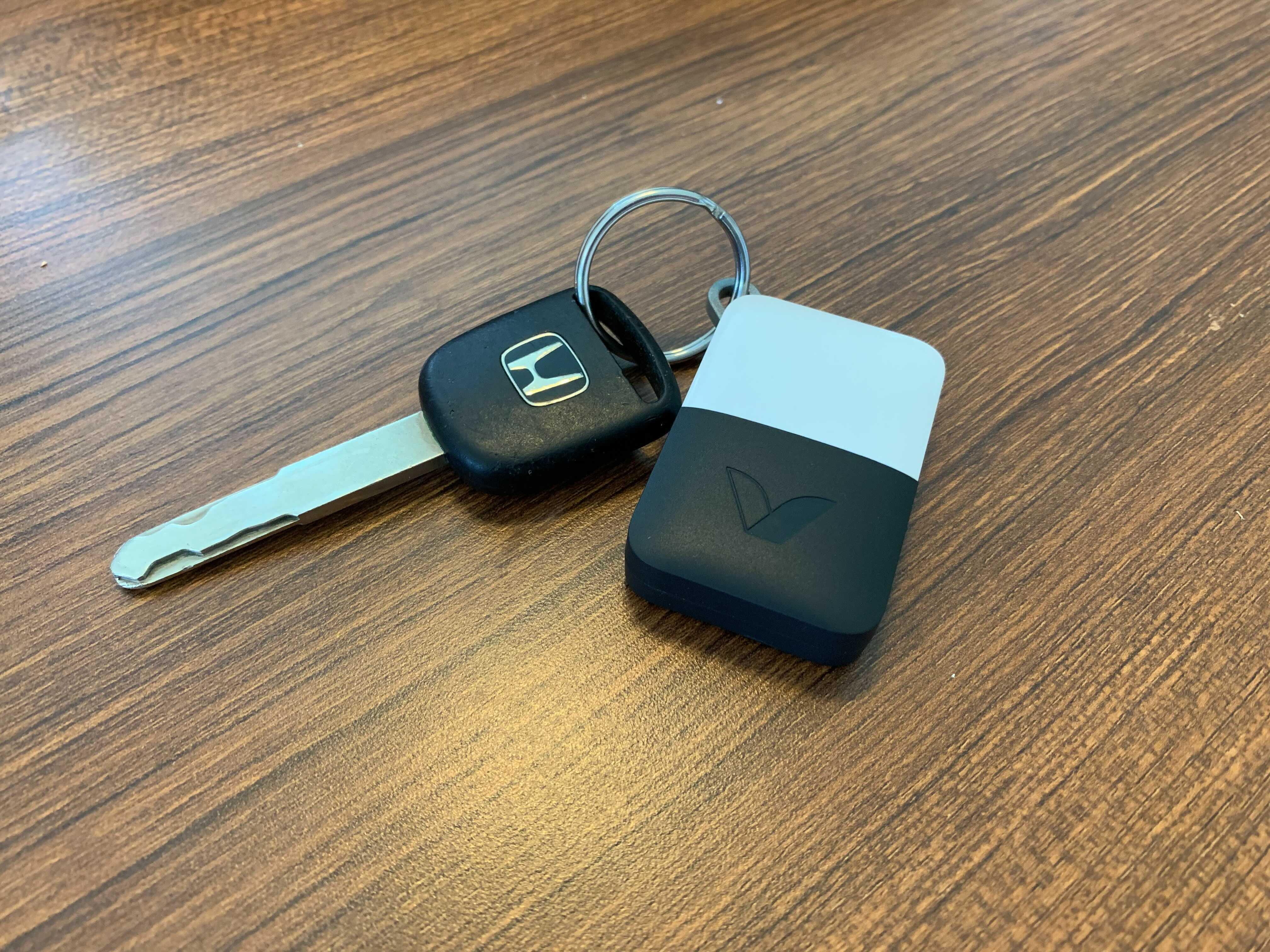<p>Abode Iota comes with a handful of devices, like this key fob, which can arm and disarm the security system.</p>