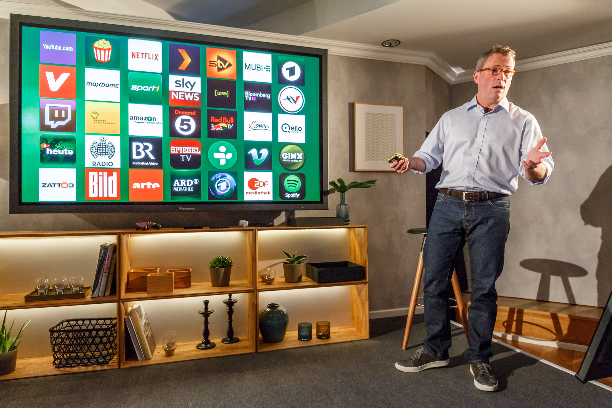 Amazon's Vice President Peter Larsen shows content partners for its Fire TV streaming-media device during the IFA electronics show.