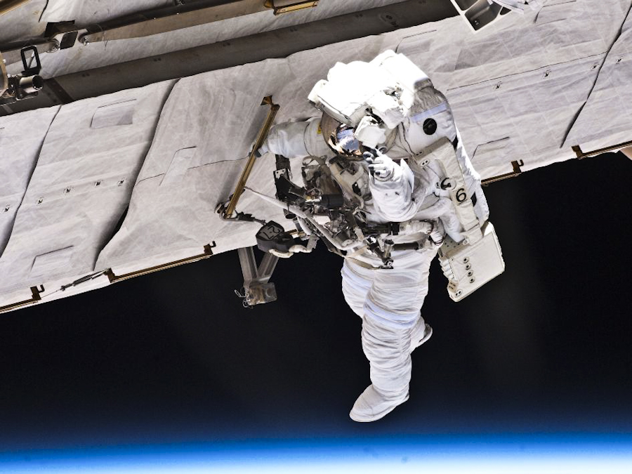 Astronaut Garrett Reisman installs a second antenna for high-speed Ku-band transmissions during his seven-hour, 25-minute spacewalk during the second of three planned spacewalks for the STS-132 mission.