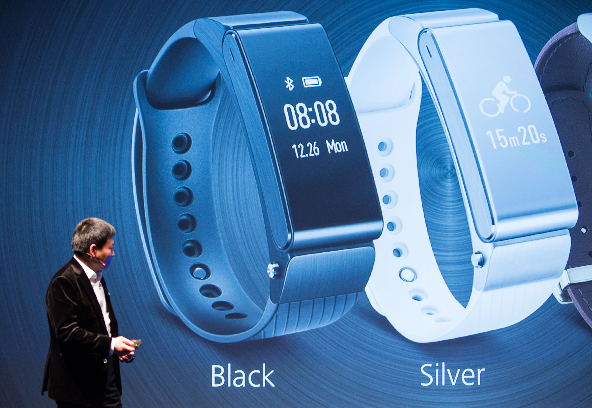 Richard Yu, CEO of Huawei's consumer group, shows the TalkBand B2 at Mobile World Congress.