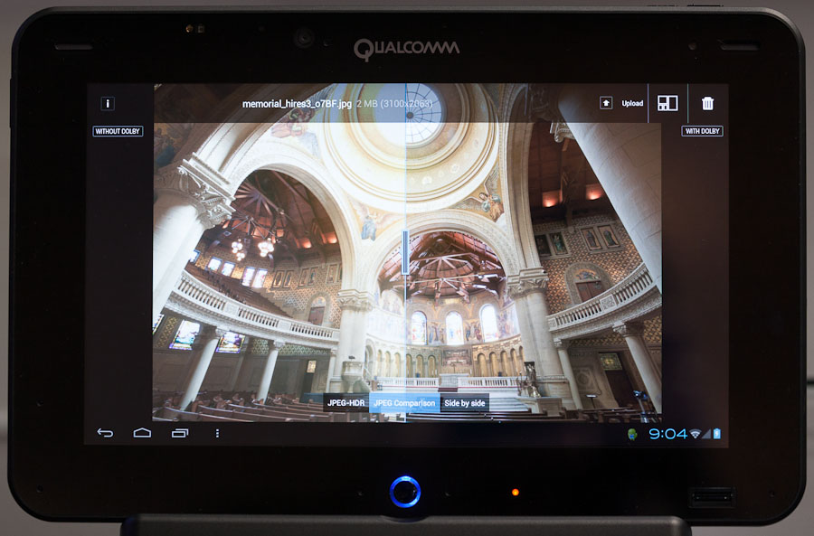Qualcomm demonstrated JPEG-HDR, a Dolby Laboratories technology for capturing and showing a better range of dark and light tones than ordinary cameras can handle, on an Android tablet at Mobile World Congress. The demo showed an image of a church interior; on the left is the ordinary JPEG image and on the right is Dolby's tone-mapped view constructed from multiple exposures ranging in brightness.