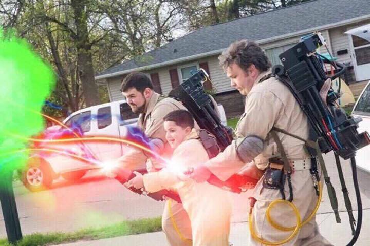 Iowa Ghostbusters members Andrew Smith (left) and Matt Bousman teach Braeden Rios how to bust some heads (in a spiritual sense, of course) during a surprise visit.