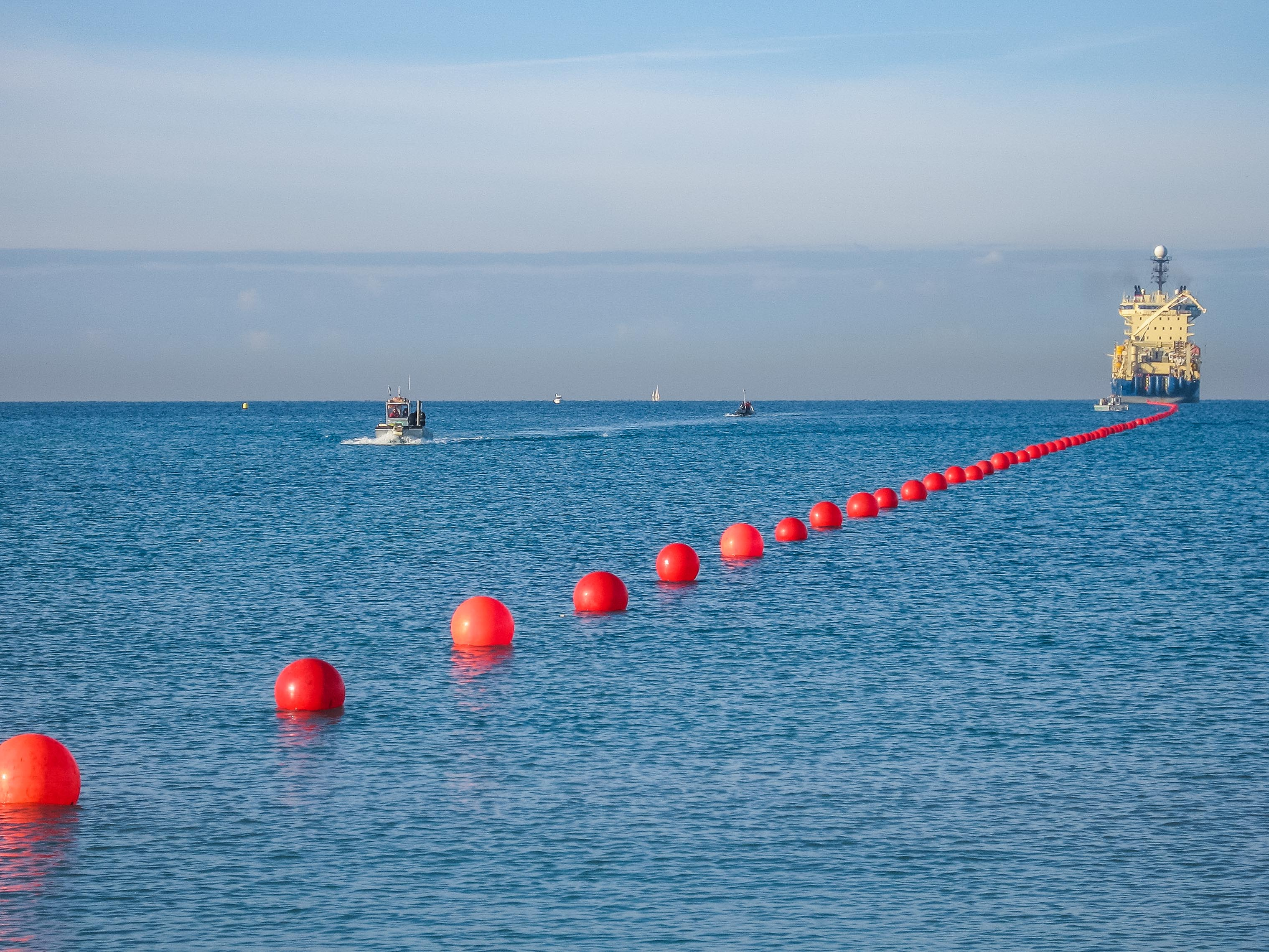 <p>A boat lays subsea cables.</p>