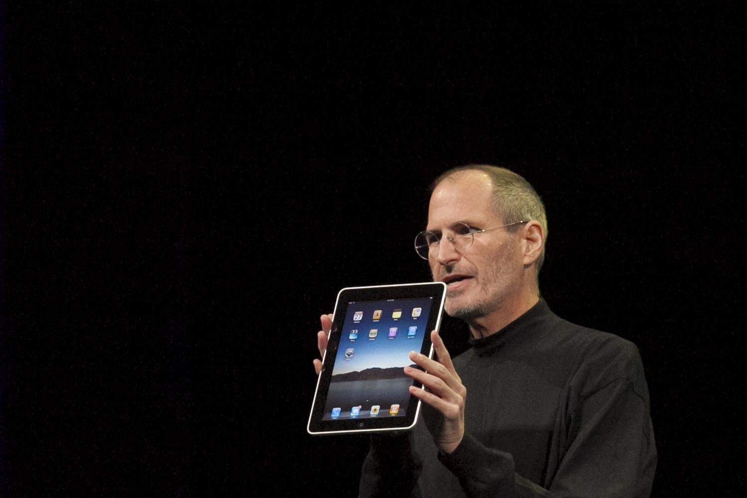 Steve Jobs shows off the first iPad in 2010.