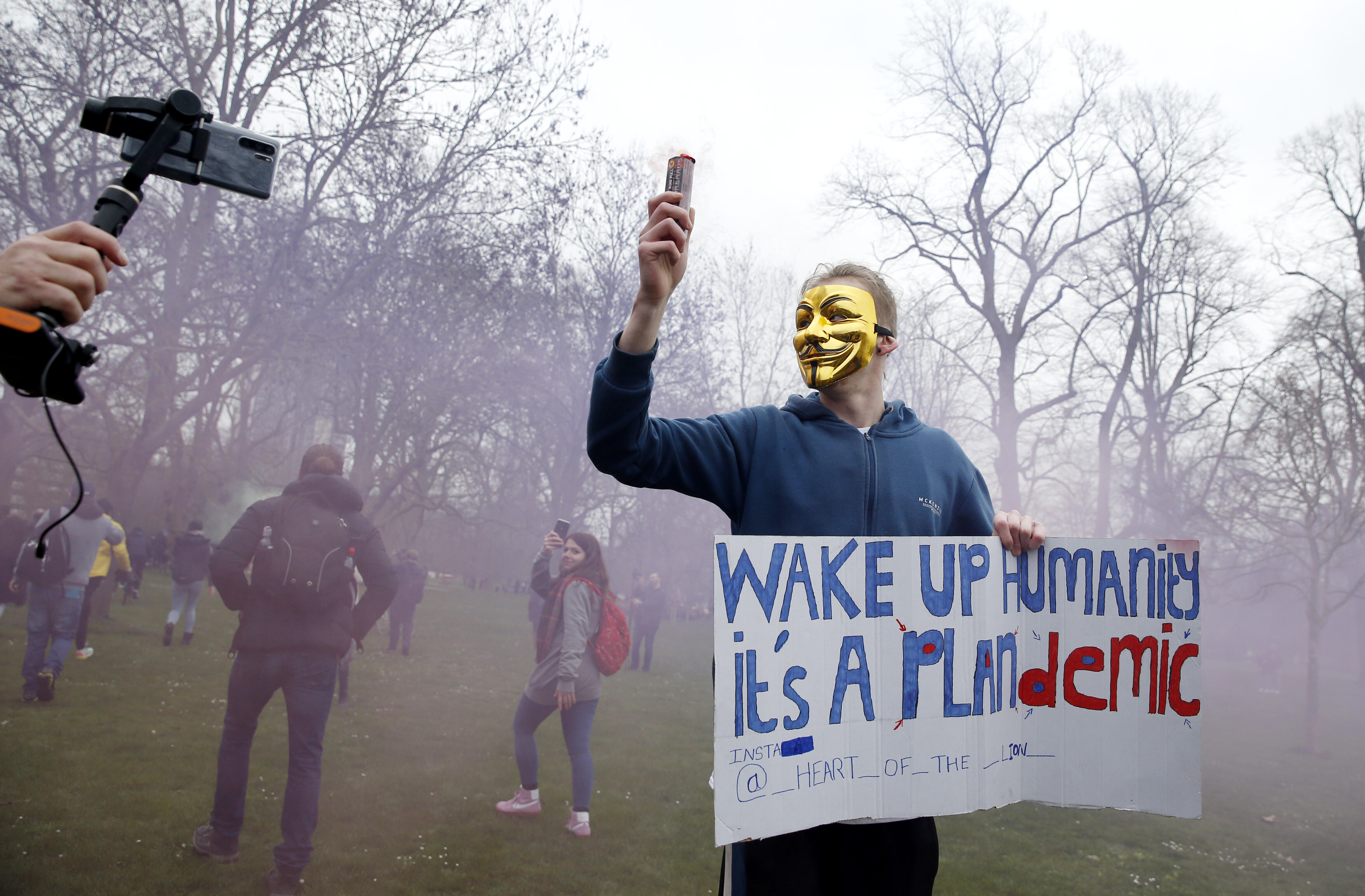 On March 20, a protester poses for a photo in London.
