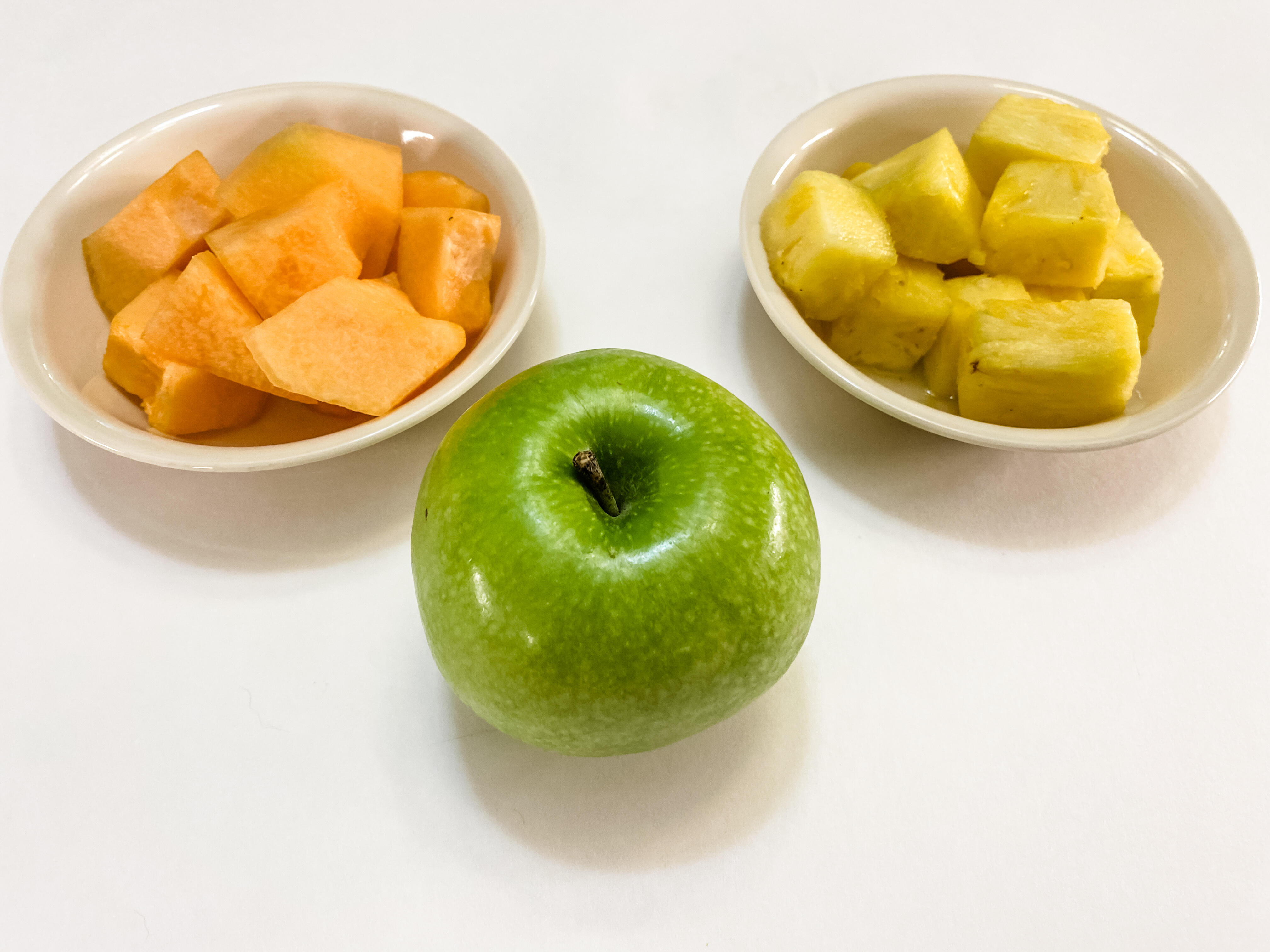 5 servings of fruit: a cup of melon, a cup of pineapple, an apple