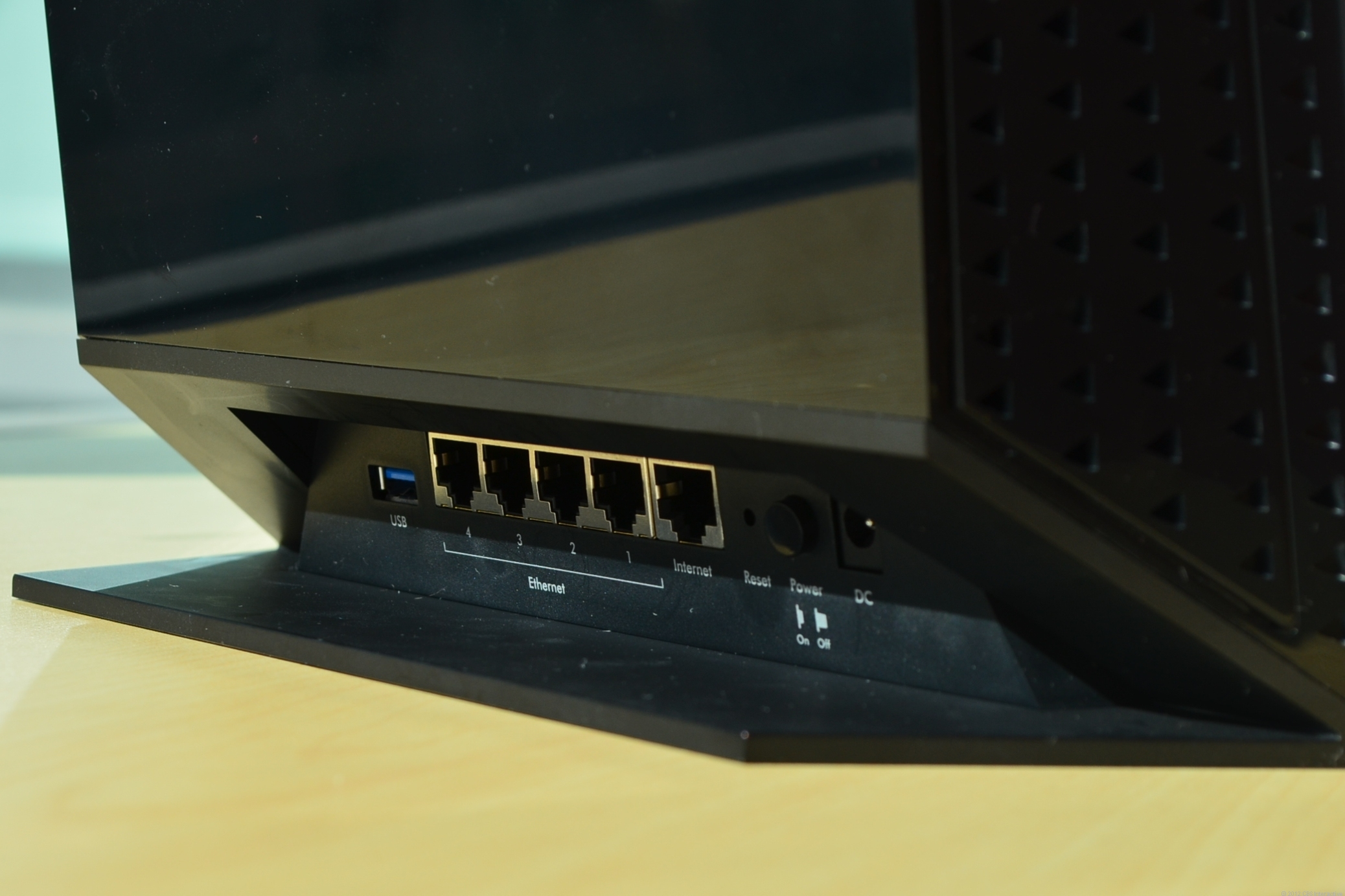 The base and the bulky part of the drive bay make it hard to reach the router's ports on the back.