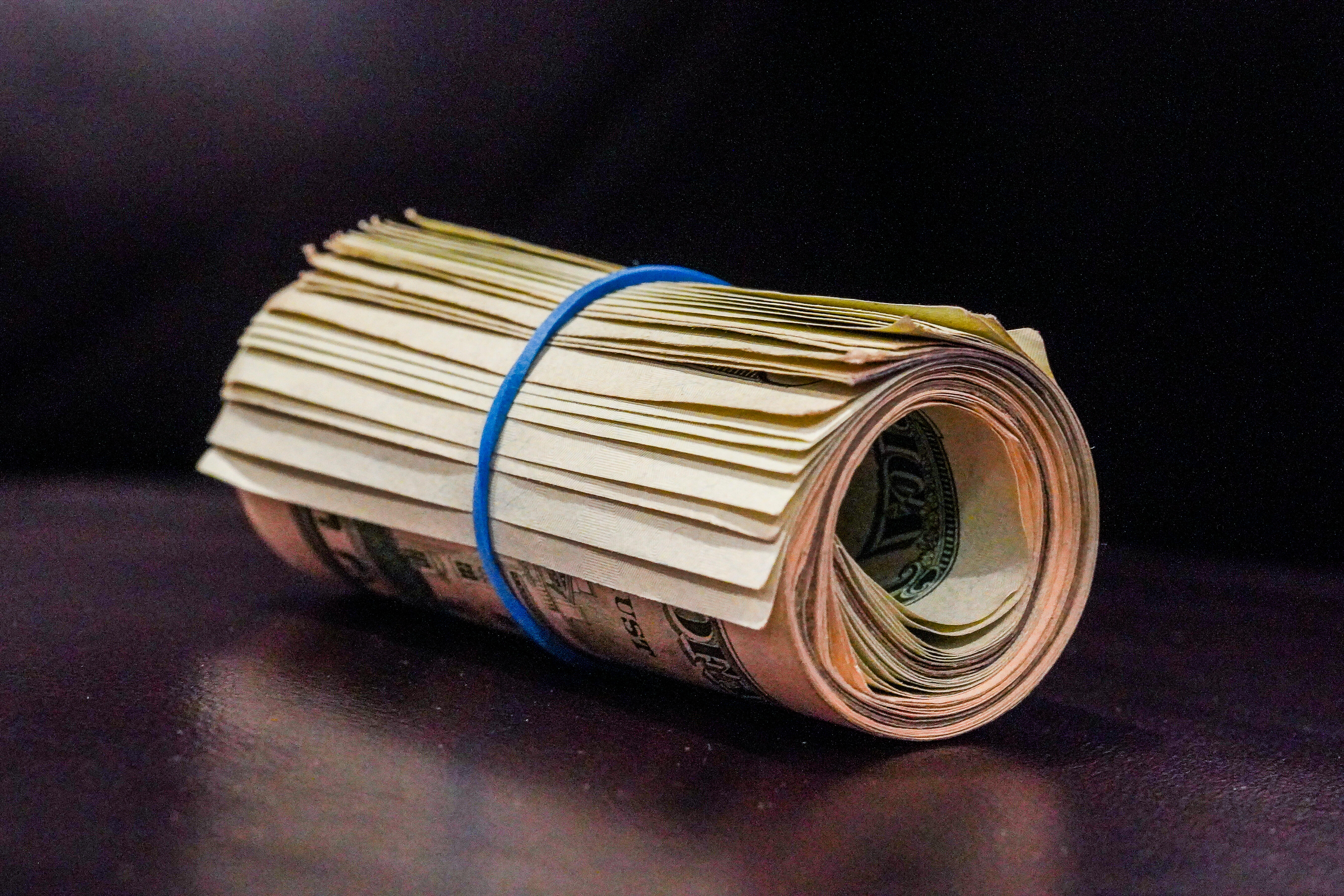 030-money-us-dollar-bills-roll-stack-cash