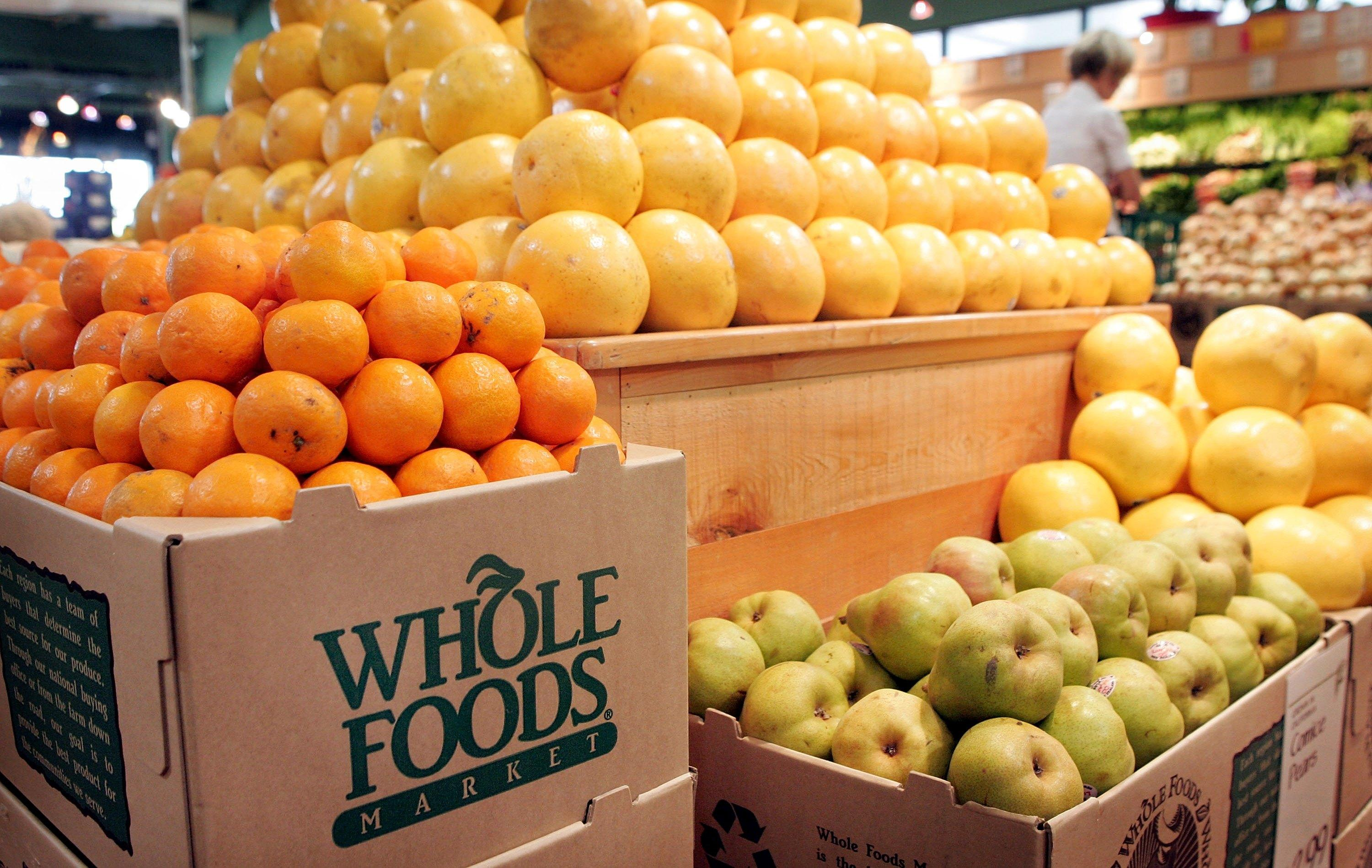 Oranges, grapefruit and pears on display at a Whole Foods store.