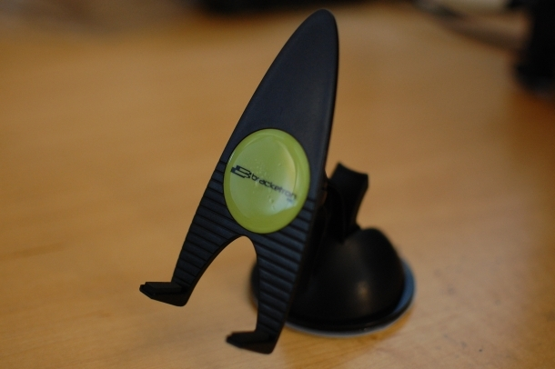 Bracketron's MobileDock uses a sticky material to hold a mobile phone in place. It also sort of looks like a Starfleet emblem.