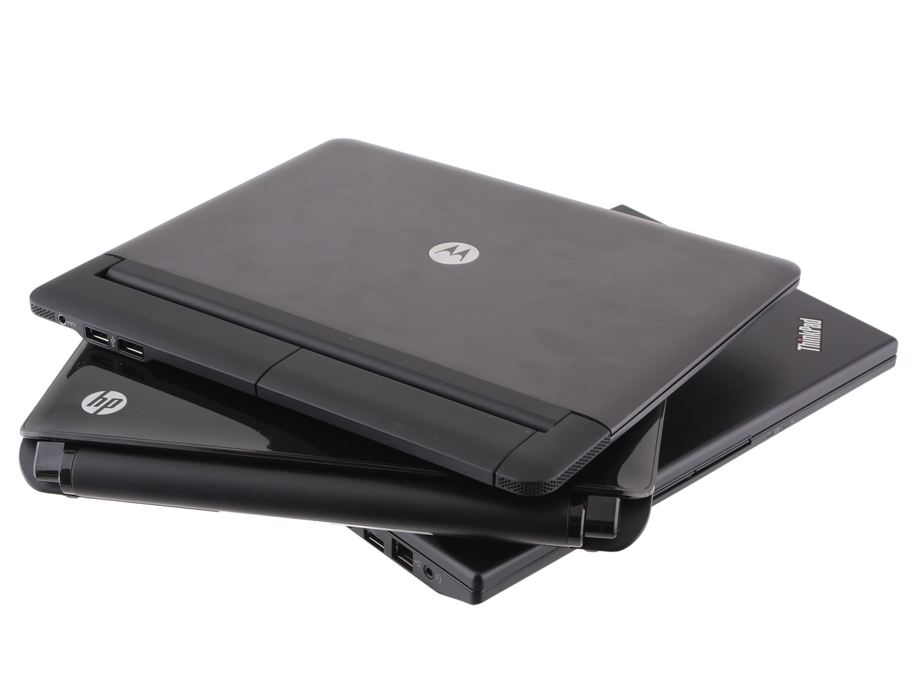 The Motorola Atrix 4G laptop dock, stacked with a ThinkPad X120e and an HP Mini 1103.