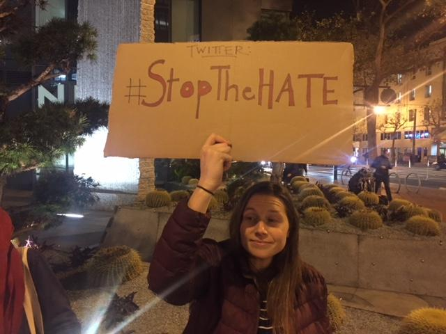 <p>Jessie Woletz demonstrates her displeasure with Twitter during a protest outside the company's San Francisco headquarters Friday night.&nbsp;</p>
