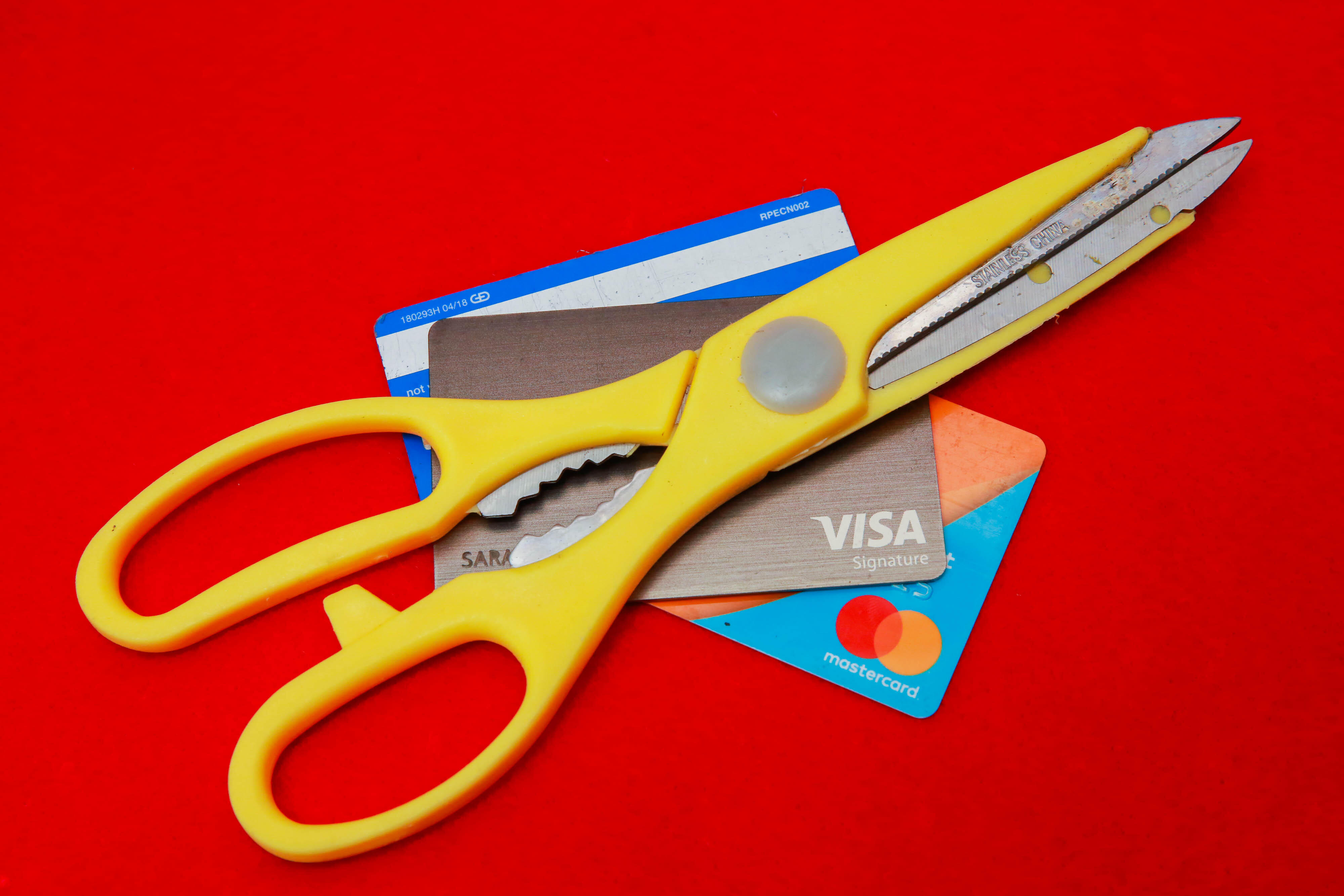 002-cutting-up-credit-cards-debt-cash-money-stimulus-debt-2