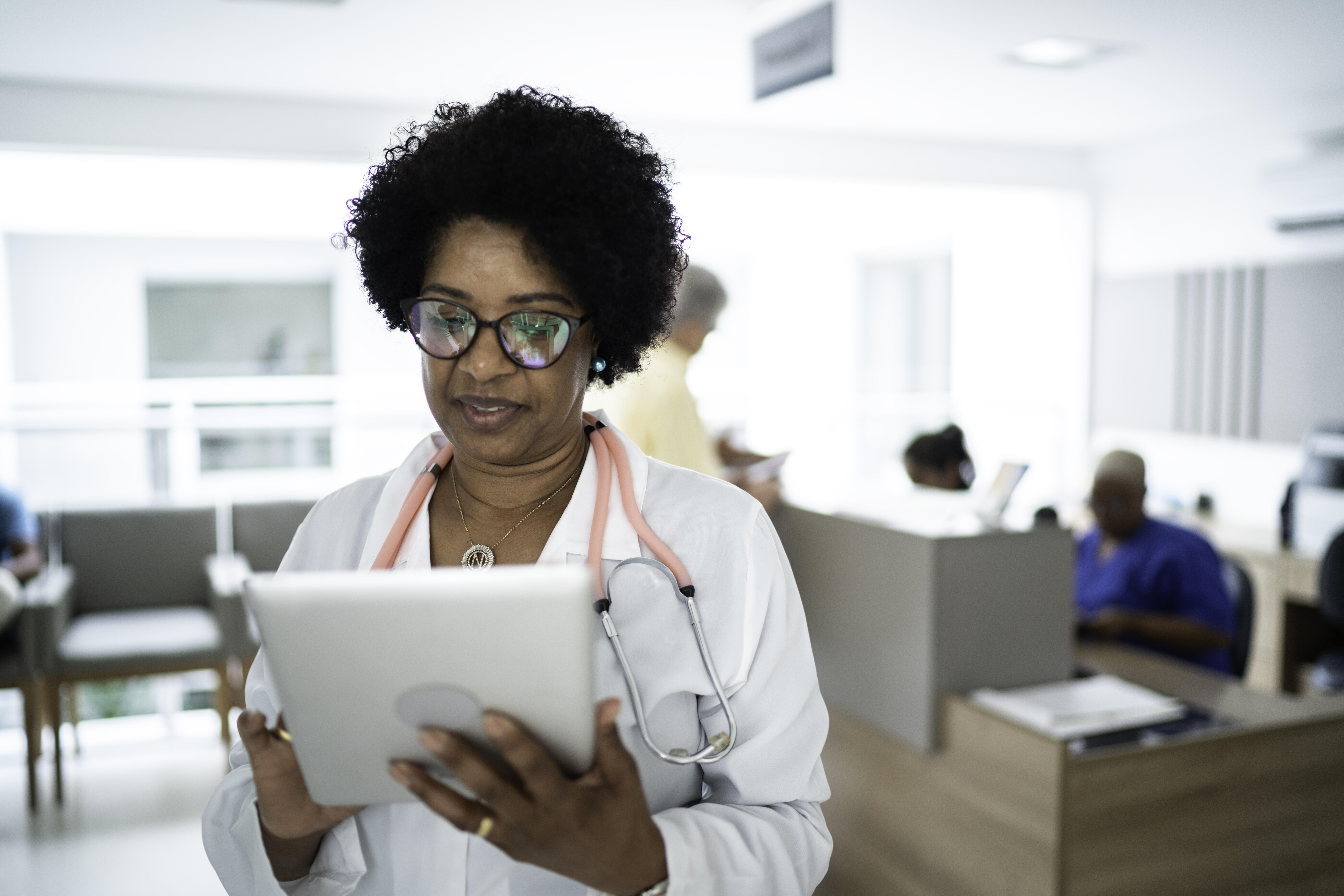 Doctor checking electronic medical records on a tablet