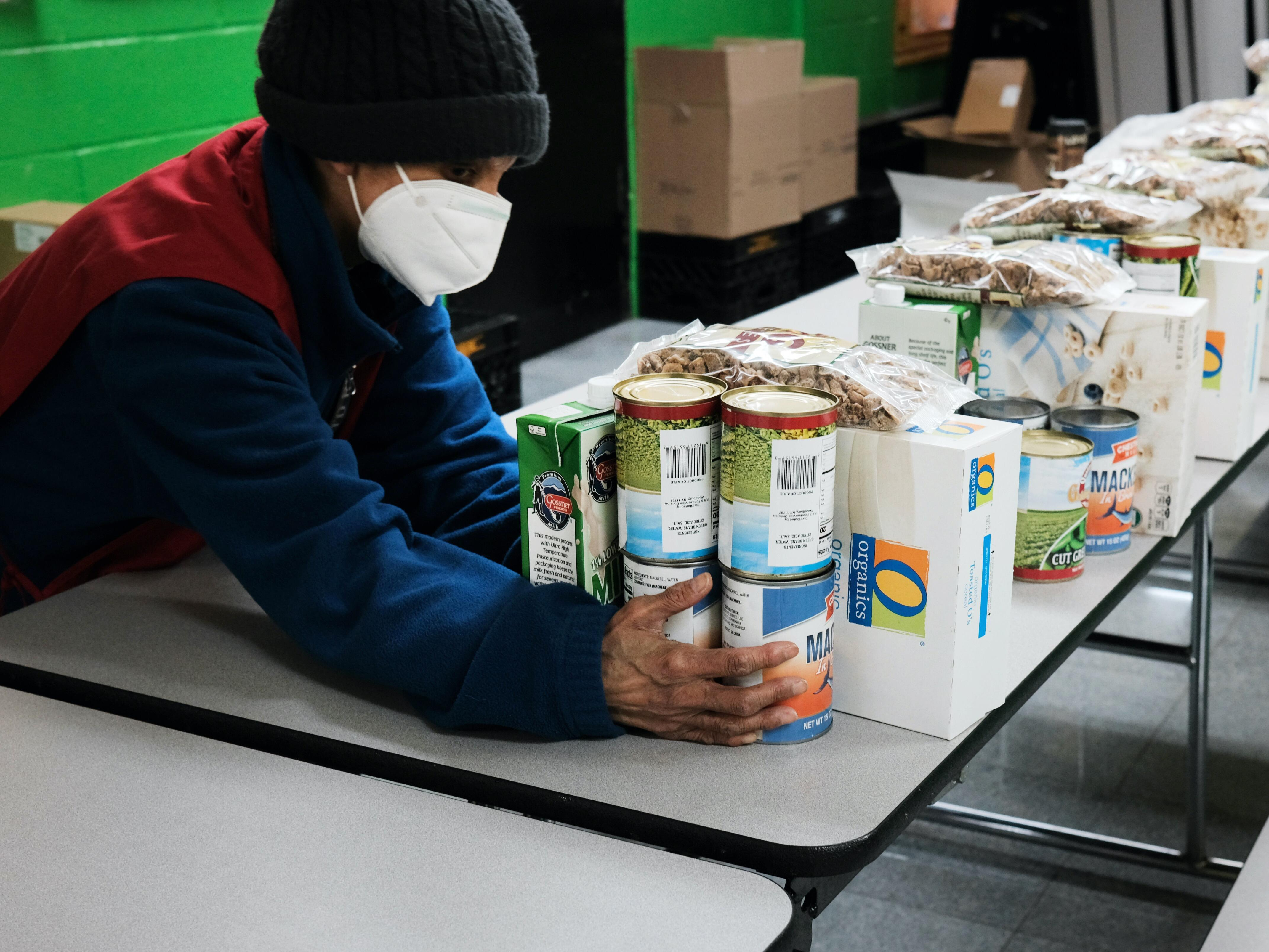 Volunteers prepare food at a food distribution center in the South Bronx, which had one of the highest COVID-19 infection rates in New York City. It's also home to an estimated 60% of New York City's very low income residents.