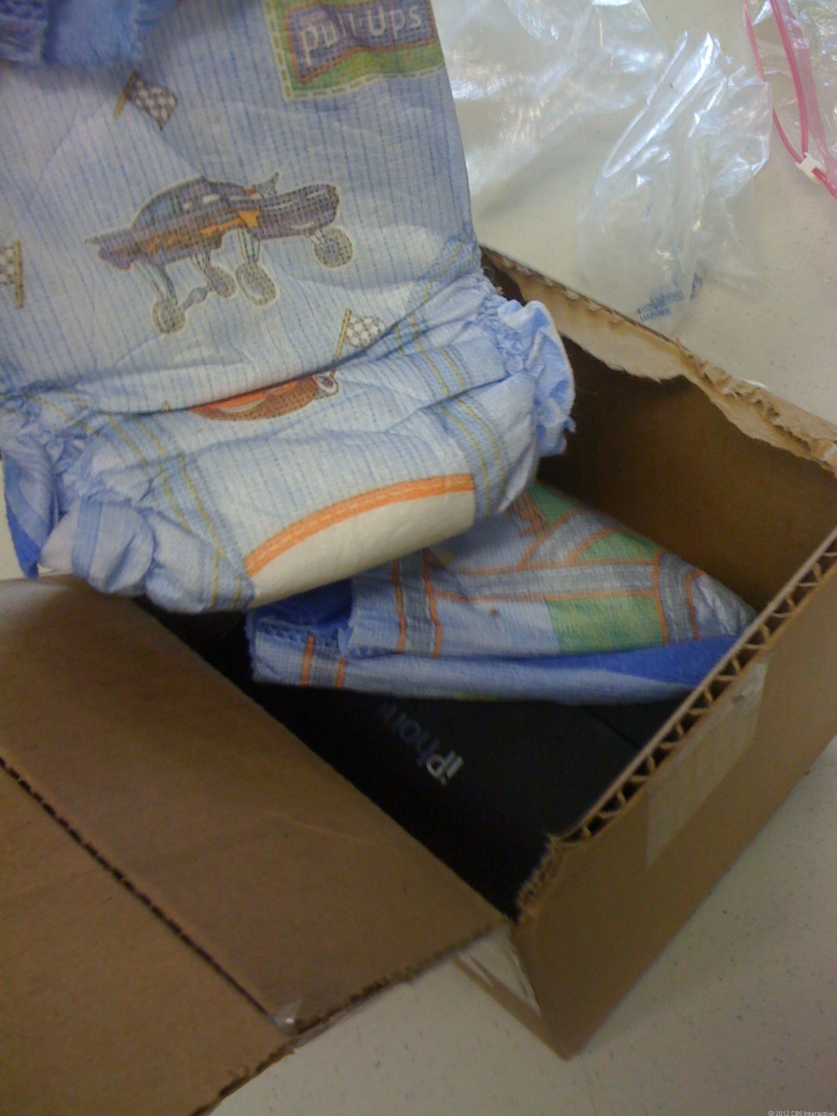 A used iPhone box padded with diapers sent in to Gazelle.