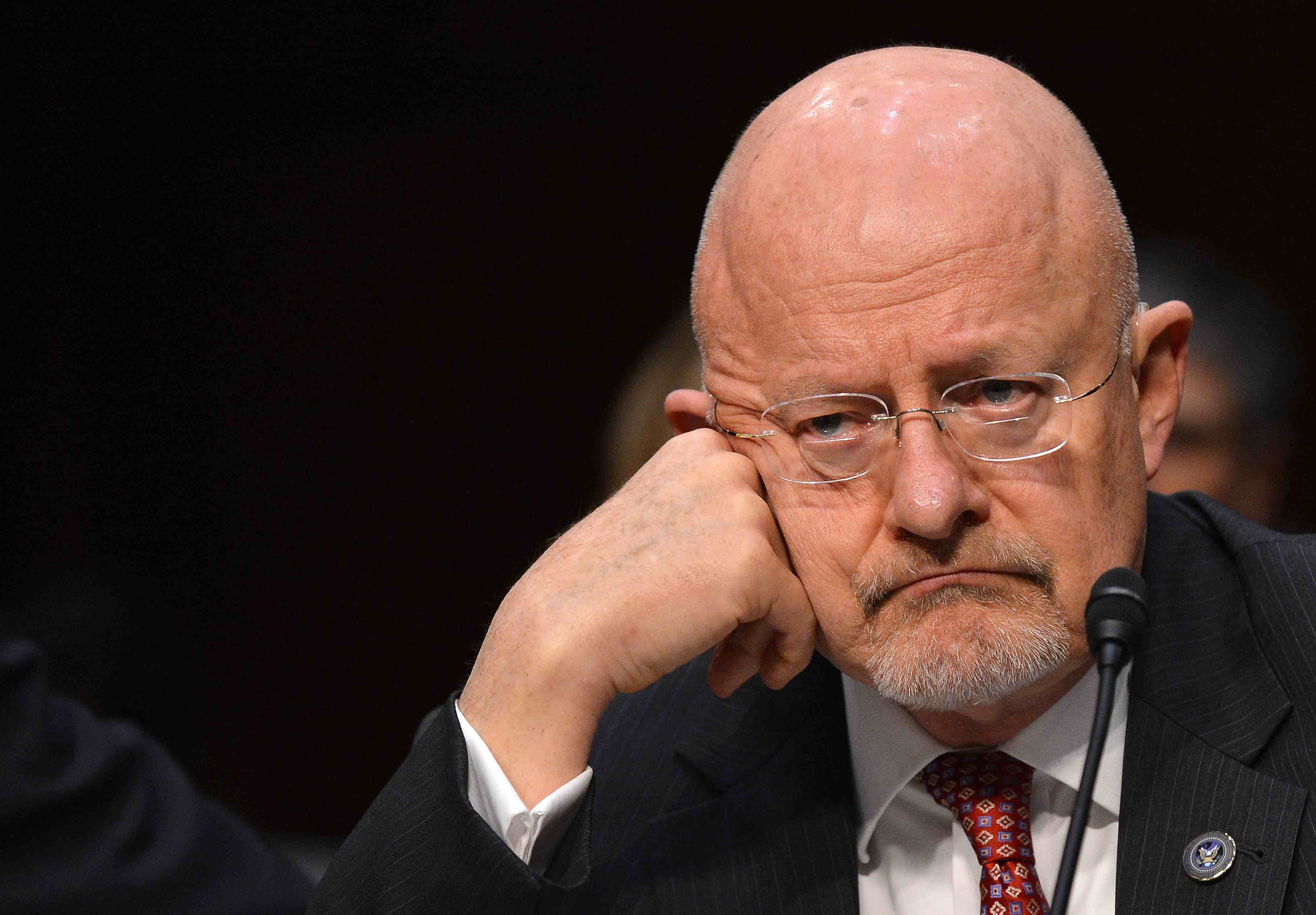 """Director of National Intelligence James Clapper, in a March file photo, denied that NSA analysts snoop on Americans' communications without """"proper legal authorization,"""" but did not say what """"proper legal authorization"""" might be."""