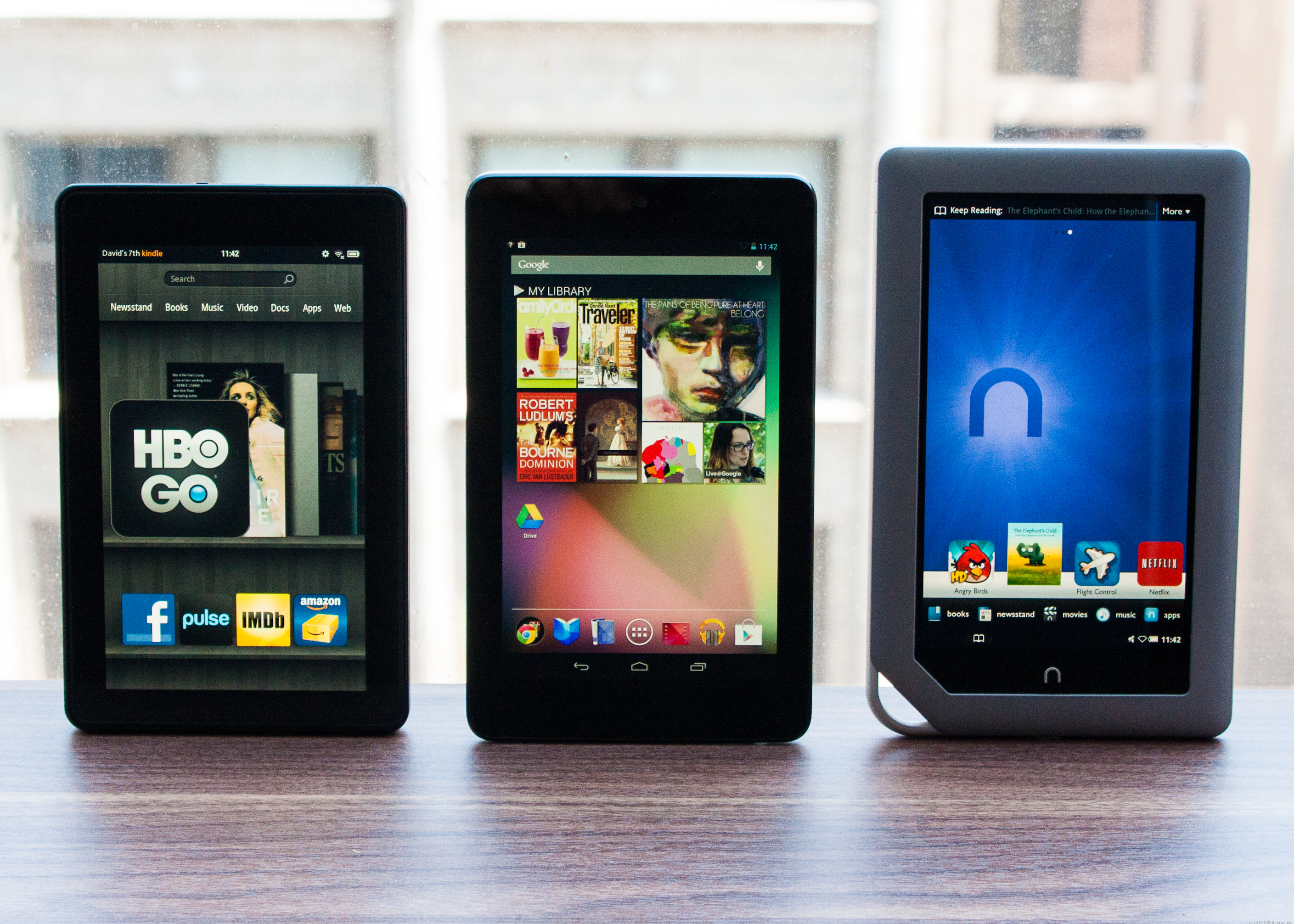 The Nexus 7 flanked by its chief competitors, the Amazon Kindle Fire and Barnes & Noble Nook Tablet.