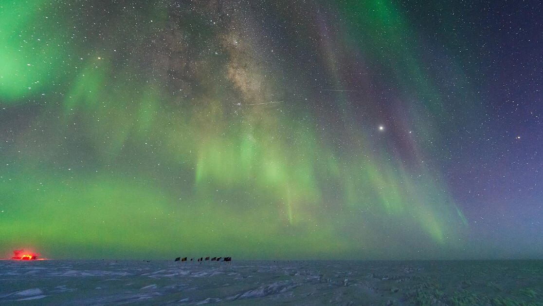 Aurora and stars, as seen from the US Amundsen-Scott South Pole Station in July 2020